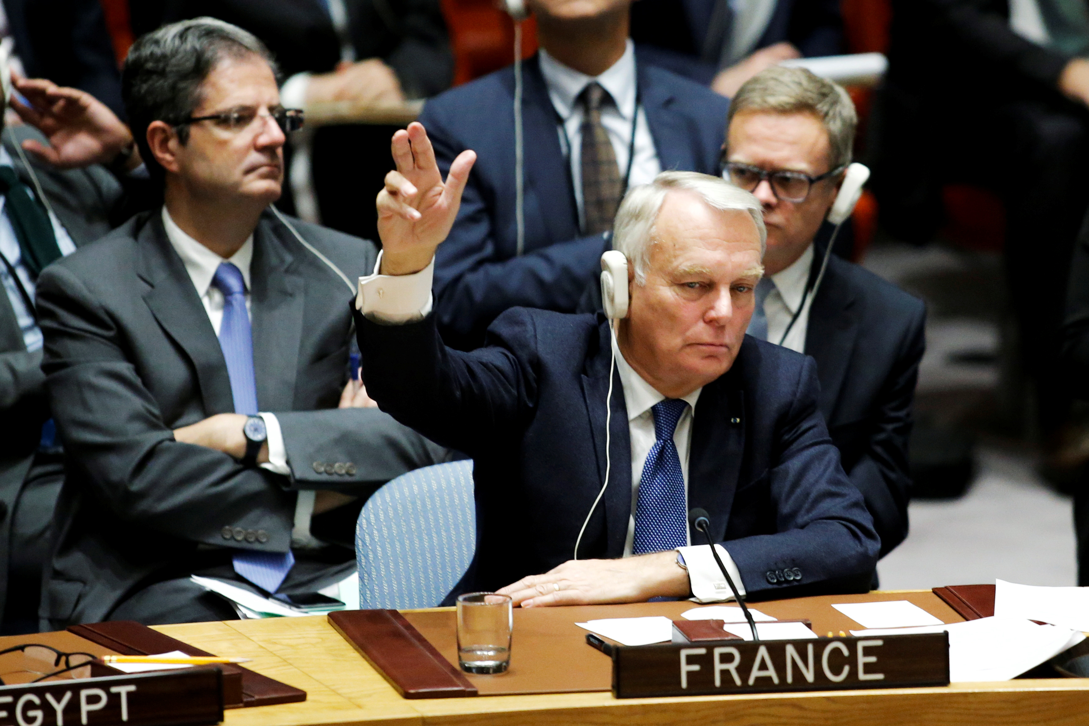 FILE - France's Foreign Minister Jean-Marc Ayrault votes in favor of a draft resolution that demands an immediate end to air strikes and military flights over Syria's Aleppo city, during a meeting of Members of Security Council at the U.N. Headquarte...