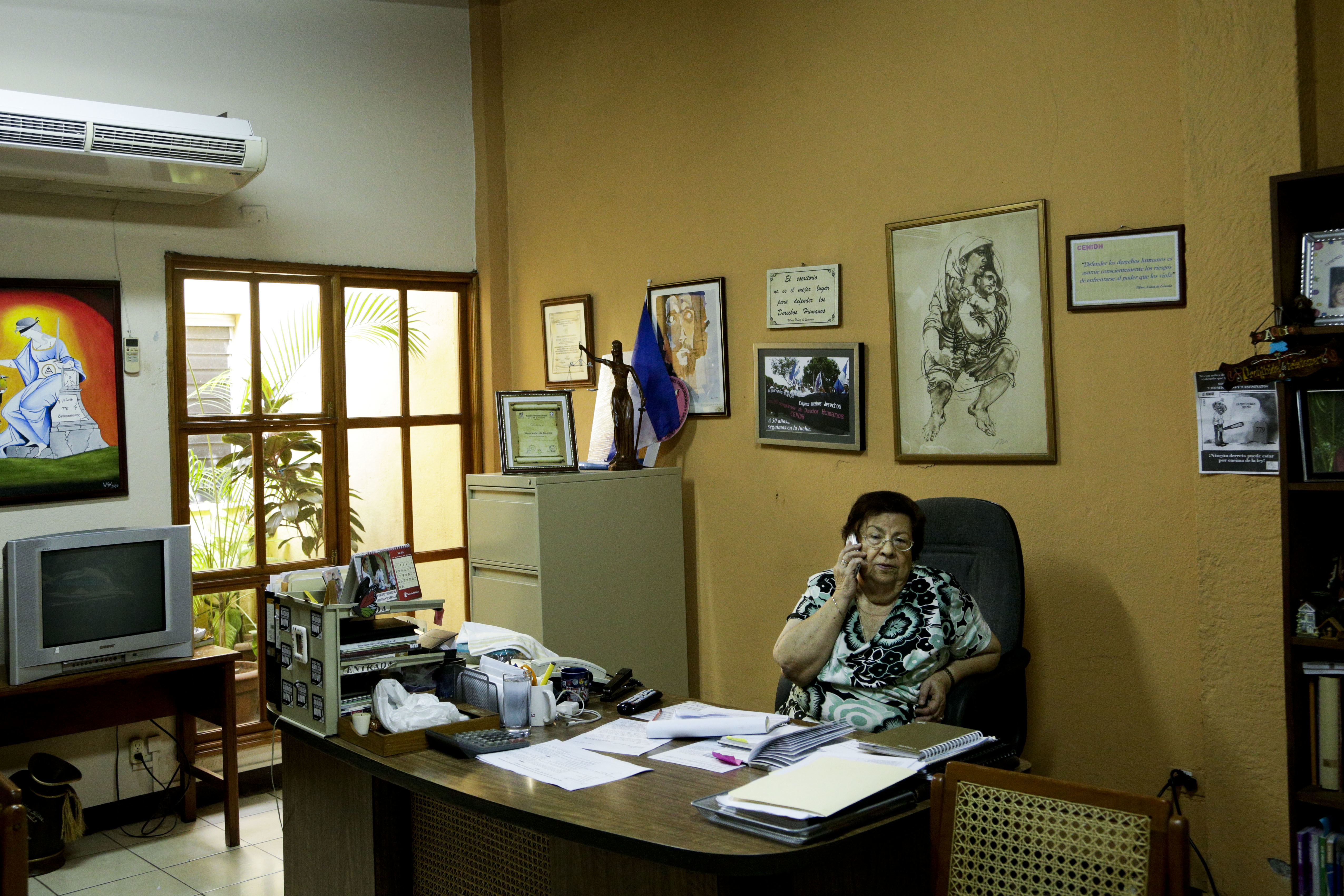 In this July 24, 2018 photo, Vilma Nunez, president of Nicaraguan Center for Human Rights talks on a phone, at her office in Managua, Nicaragua.