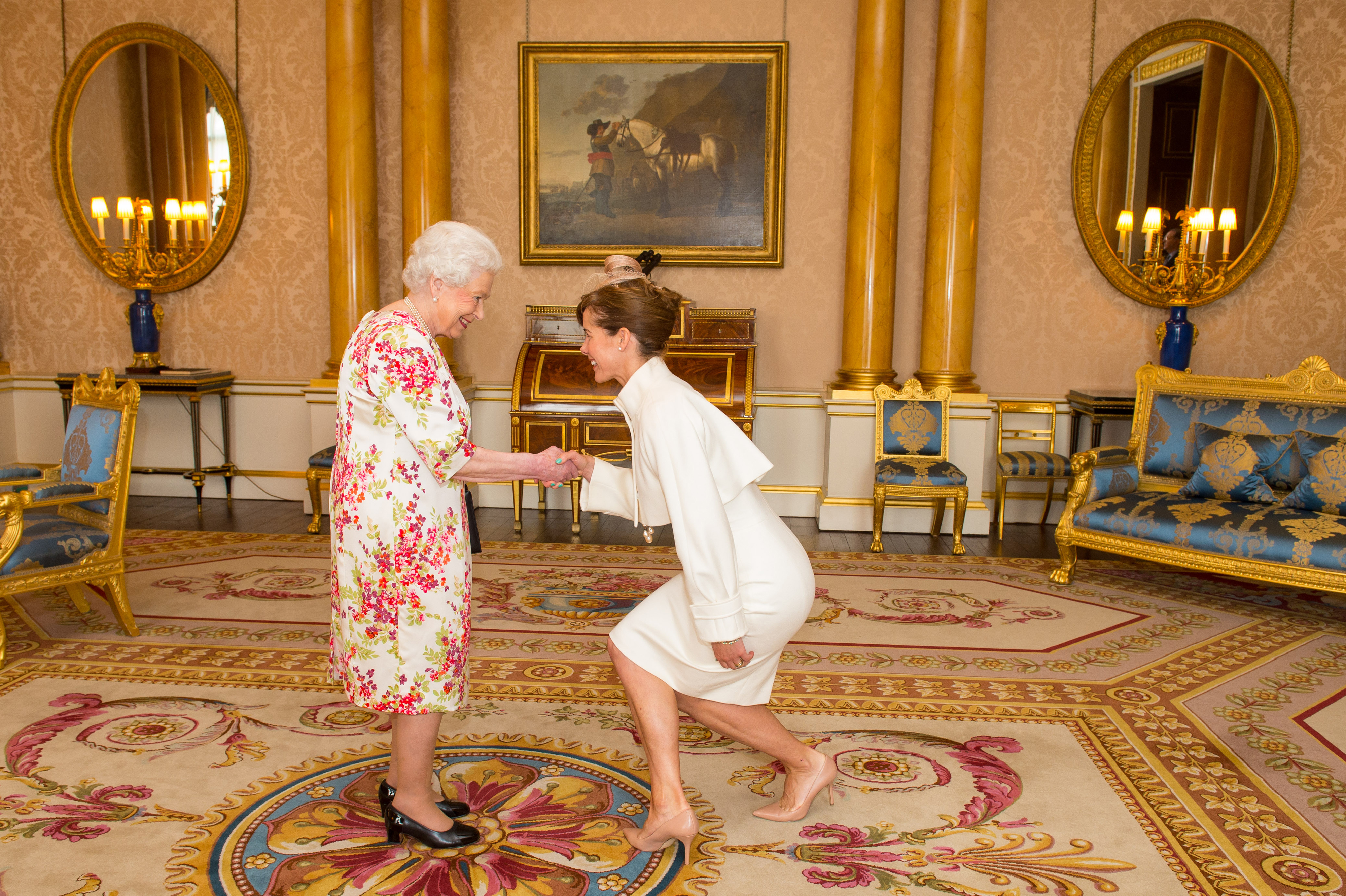 FILE - President of the Royal Academy of Dance Darcey Bussell meets Britain's Queen Elizabeth at Buckingham Palace, in central London, Britain, June 24, 2016.