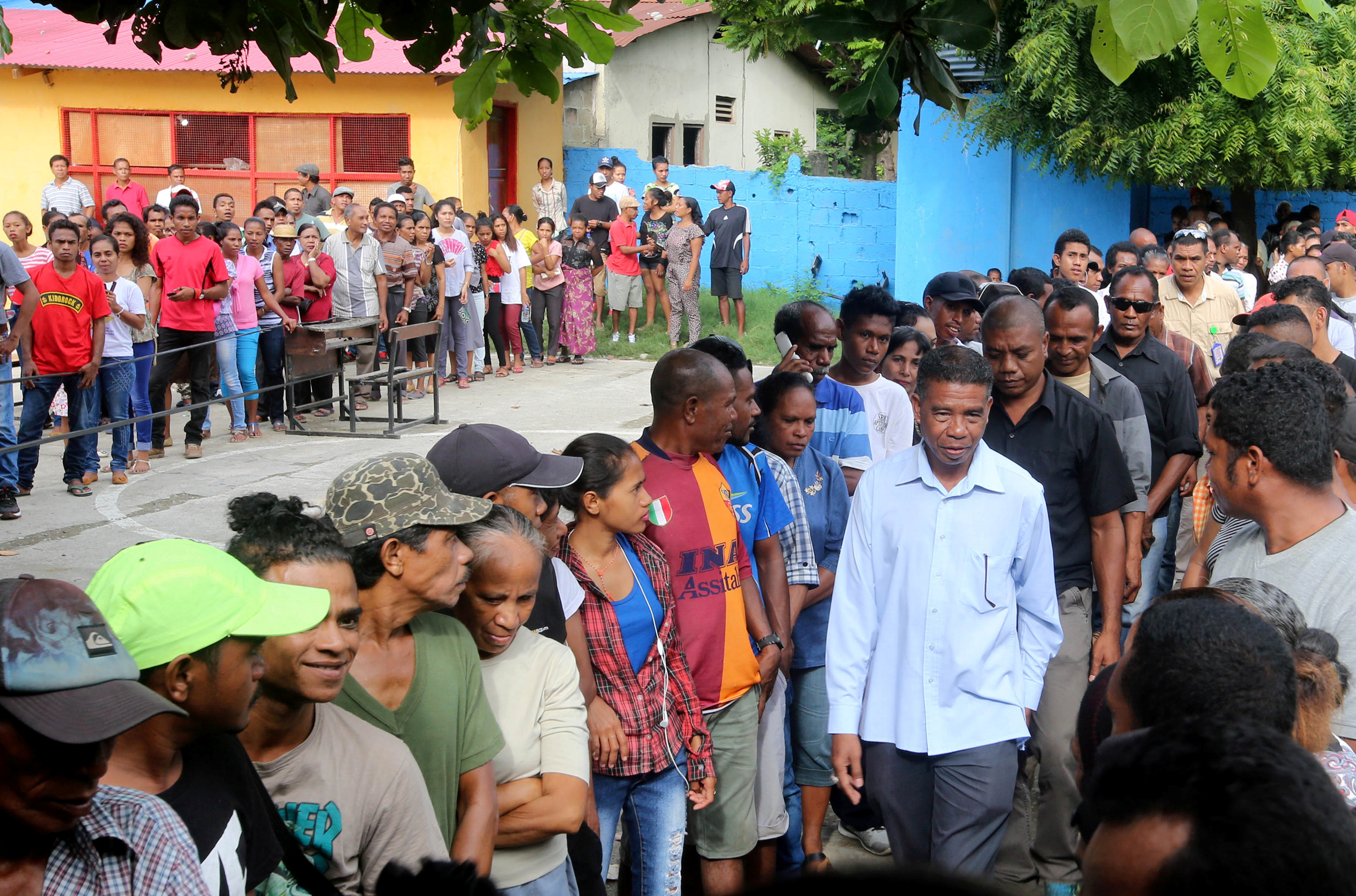 East Timor presidential candidate Antonio da Conceicao from the Democratic Party (R) arrives to cast his ballot during the presidential election at a polling station in Dili, East Timor, March 20, 2017.