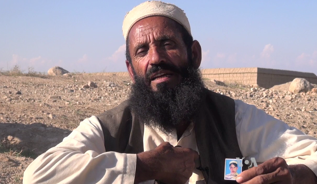 Abdul Malik, the gather of a victim of the Islamic State group's brutality in the Achin district of eastern Afghanistan.