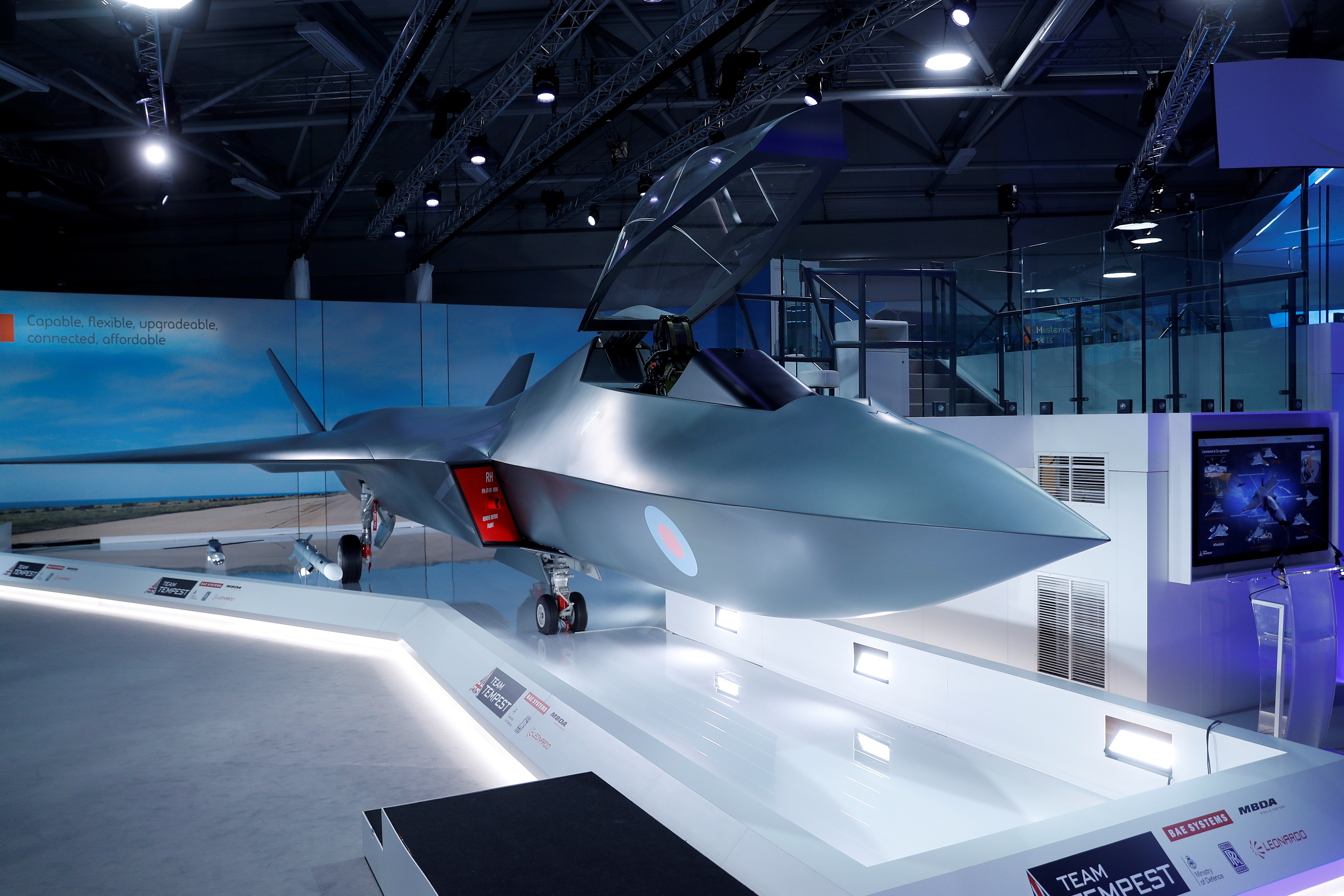 FILE - A model of a new British jet fighter, called Tempest, is unveiled at the Farnborough Airshow, in Farnborough, Britain, July 16, 2018.