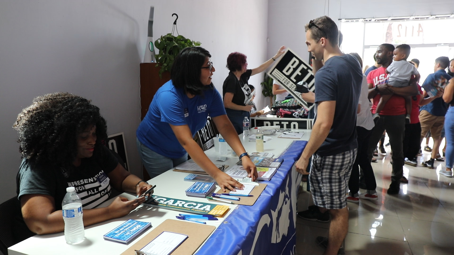 Local organizations set up tables to register people to vote at a Beto O'Rourke rally.