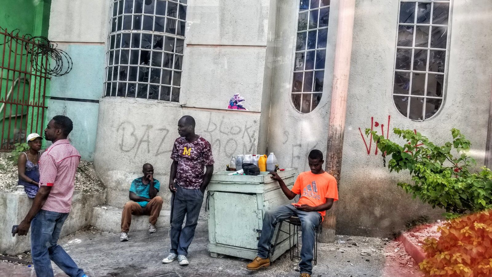 Haitians on a street corner in Petionville. (S. Lemaire/VOA)
