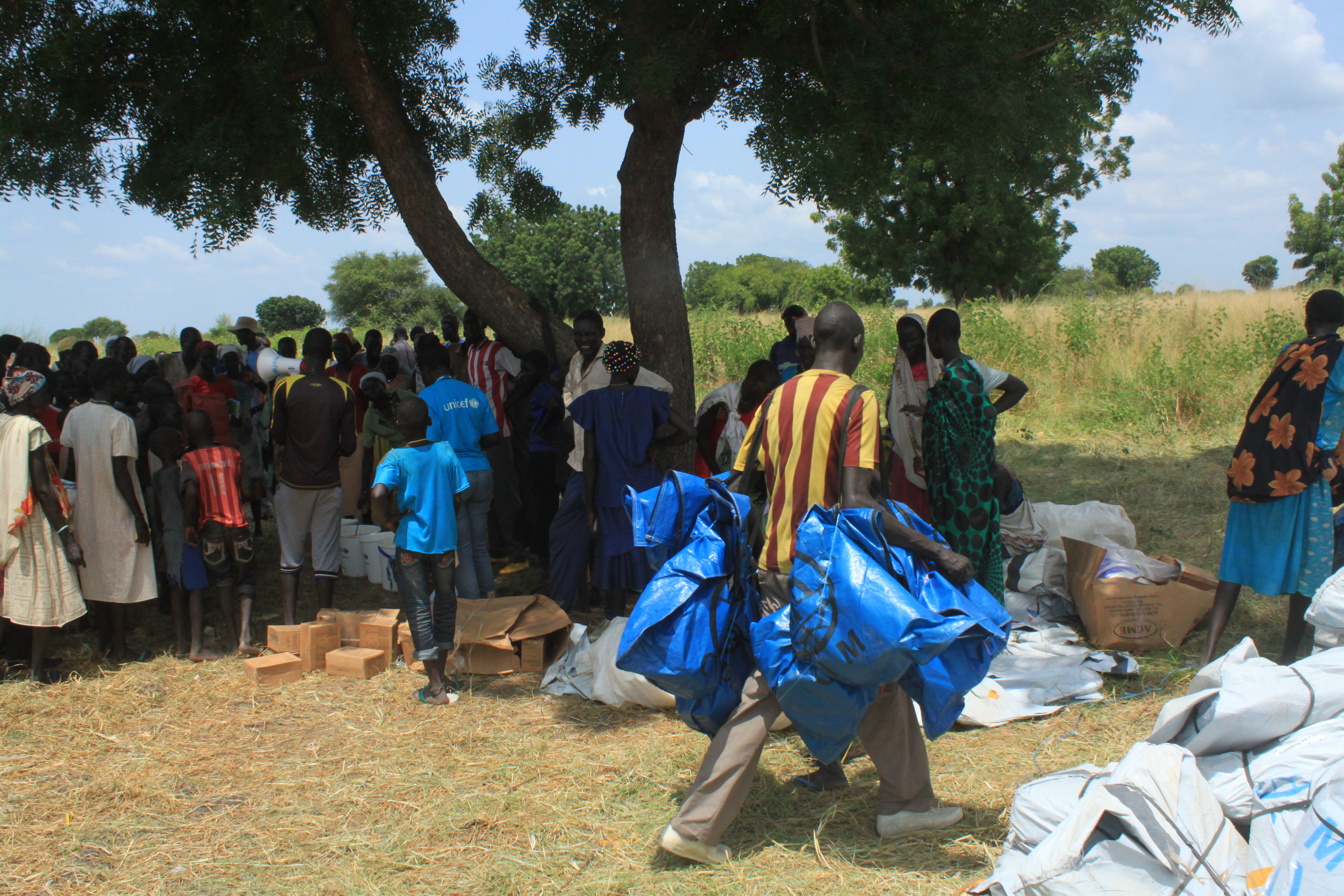 People in the town of Koch, in South Sudan's Unity state, are given tents for temporary shelter on Sept. 25, 2015, when the World Food Program and UNICEF resumed aid deliveries to the area after a four-month break.