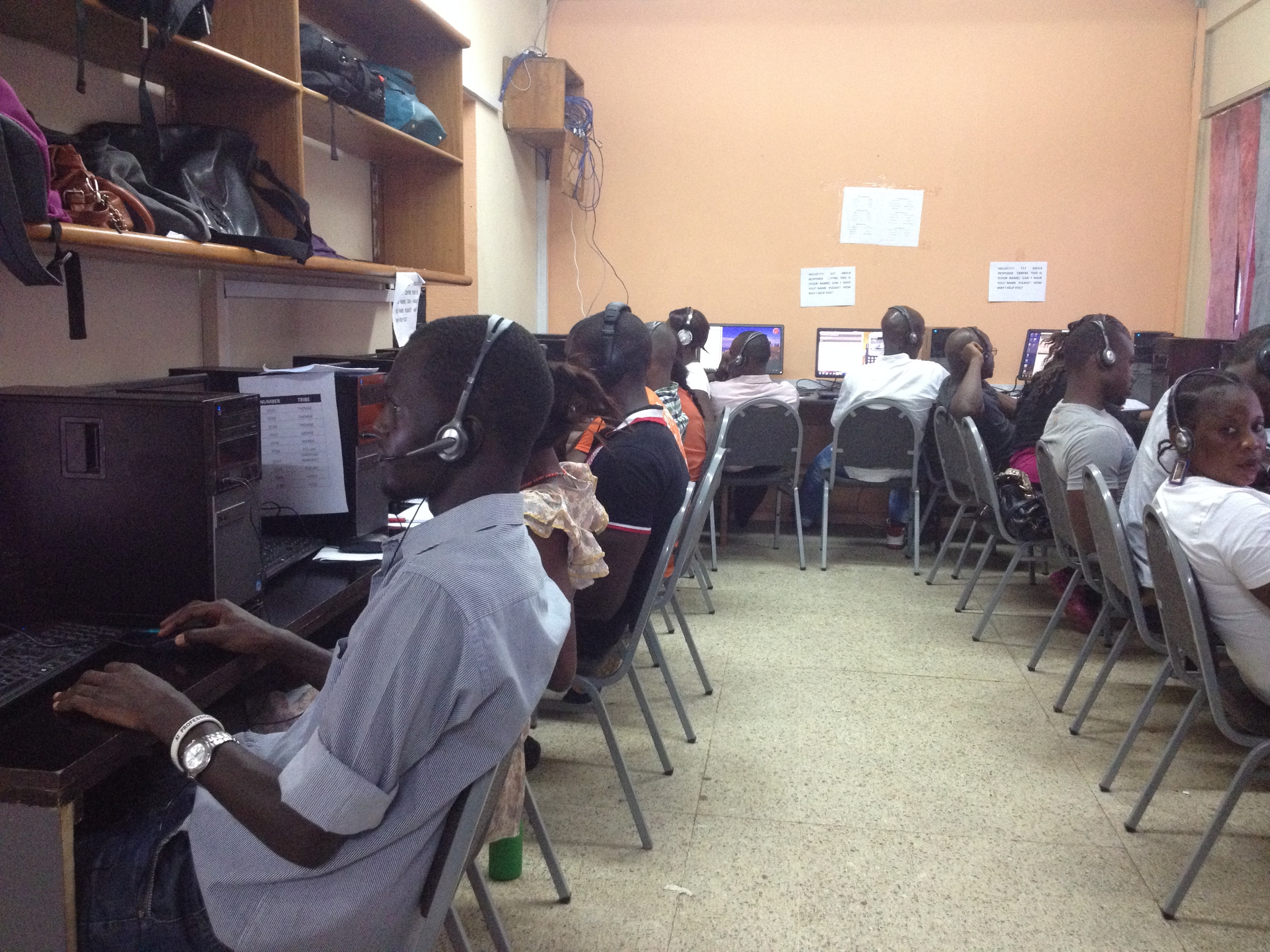 The 117 call center staffs about 52 employes per shift, Freetown, Sierra Leone, Oct, 30, 2014. (Nina deVries / VOA)