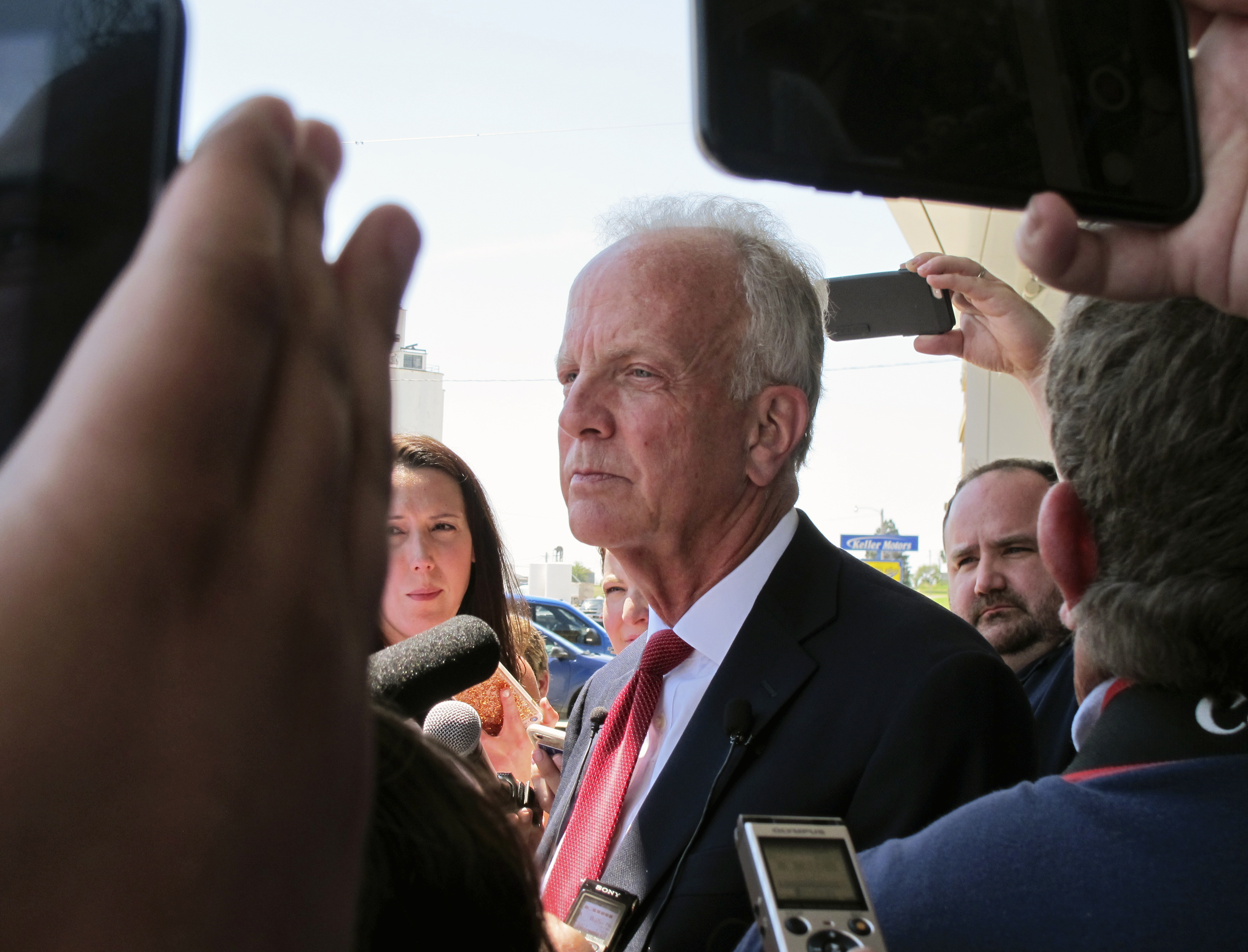U.S. Sen. Jerry Moran, R-Kan., speaks to reporters following a town hall meeting, July 6, 2017, in Palco, Kan. Critics of GOP efforts to overhaul traveled to the tiny town in western Kansas to pressure Moran.