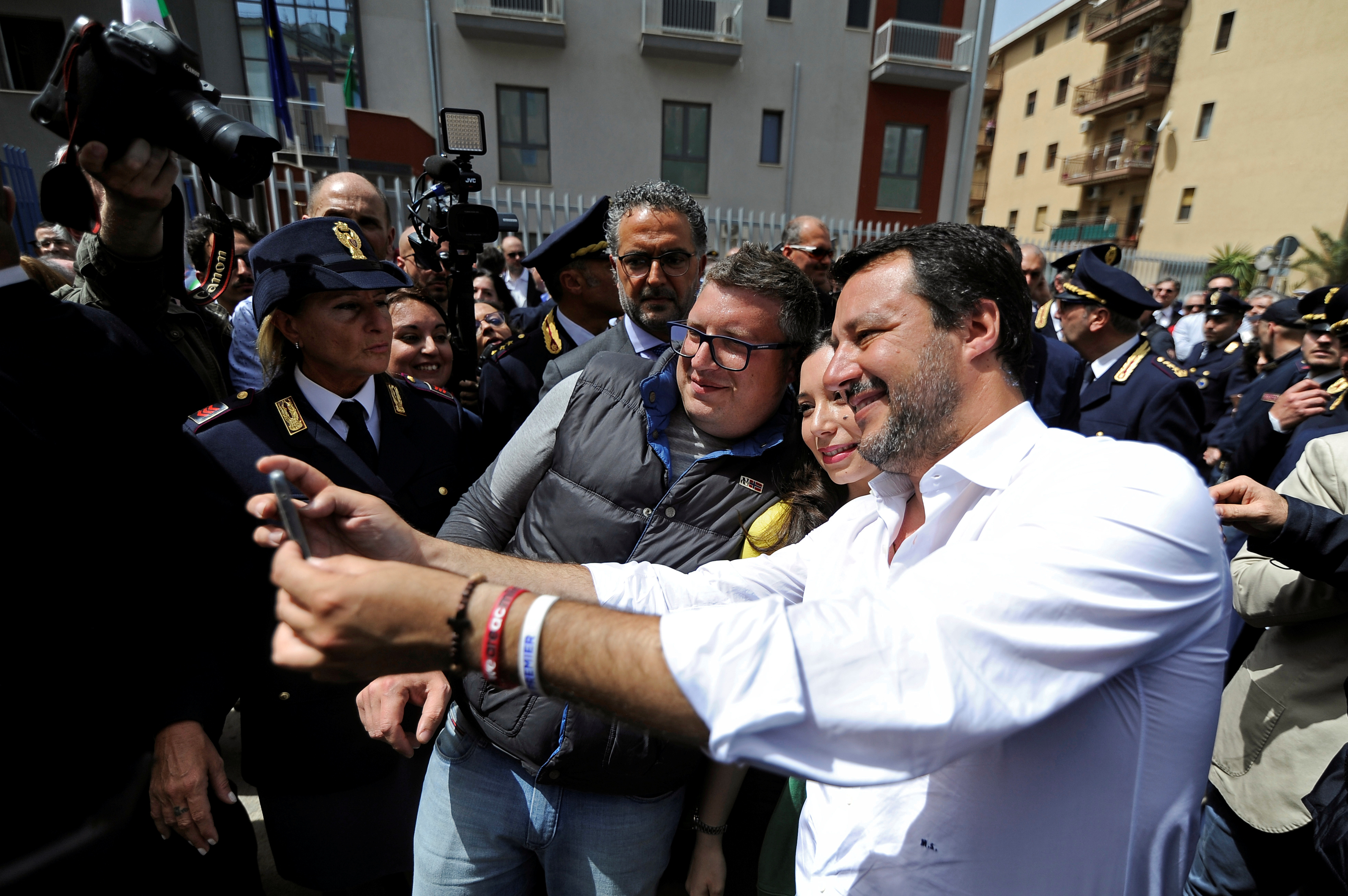 FILE - Italian Interior Minister Matteo Salvini takes a selfie with supporters in Corleone, Sicily, Italy April 25, 2019.