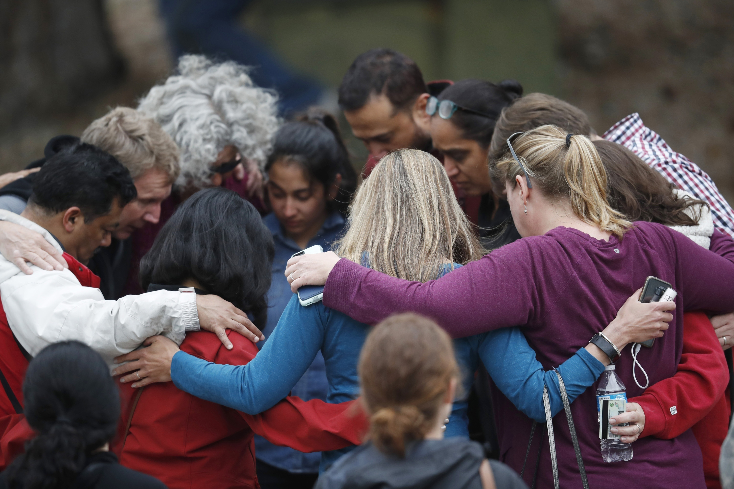 Parents gather in a circle to pray at a recreation center where students were reunited with their parents after a shooting at a suburban Denver middle school in Highlands Ranch, Colorado, May 7, 2019.