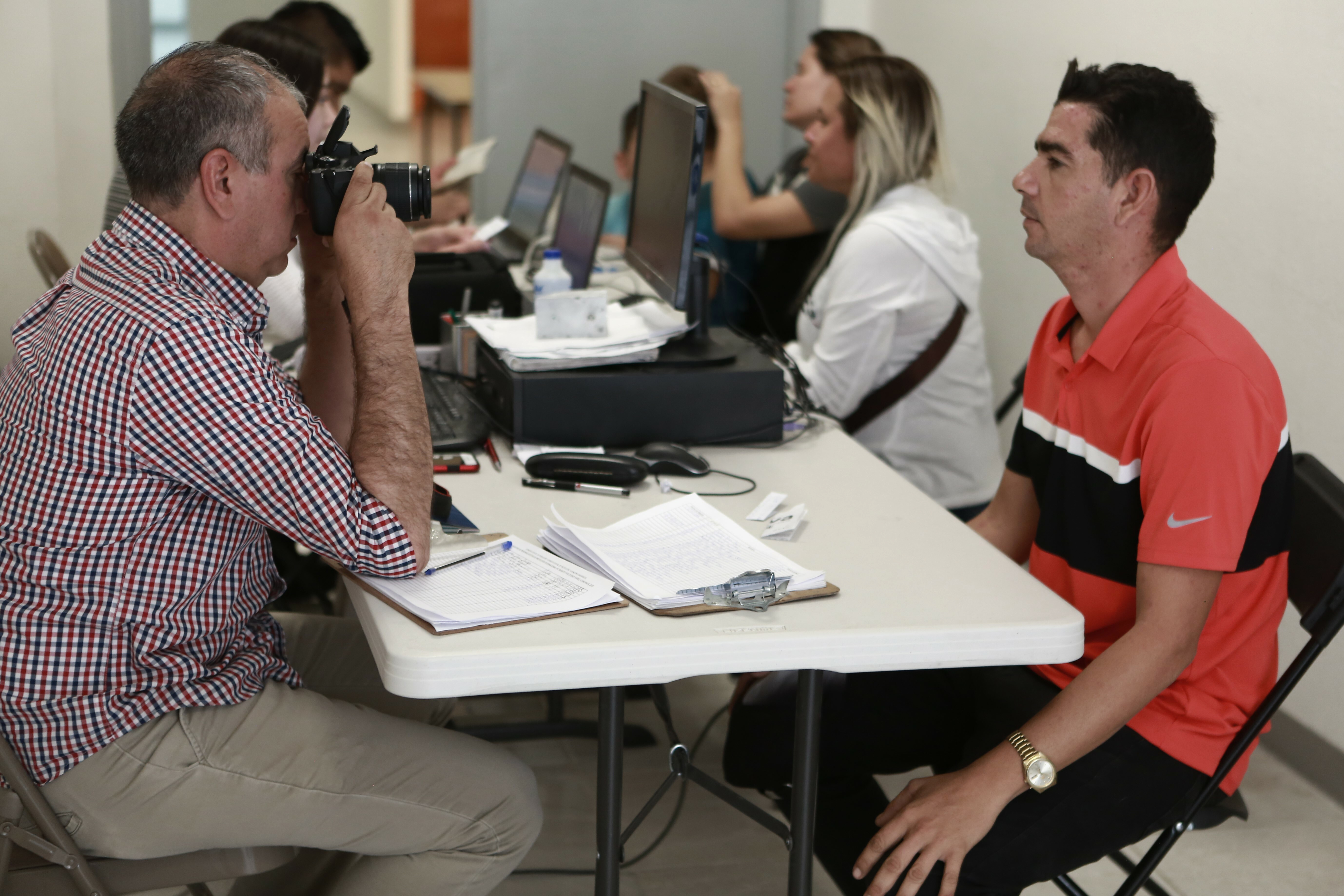 Cuban migrants are registered by Mexican immigration officials in Ciudad Juarez, to be taken across the Paso del Norte International bridge to be processed as asylum-seekers on the U.S. side of the border, April 29, 2019.