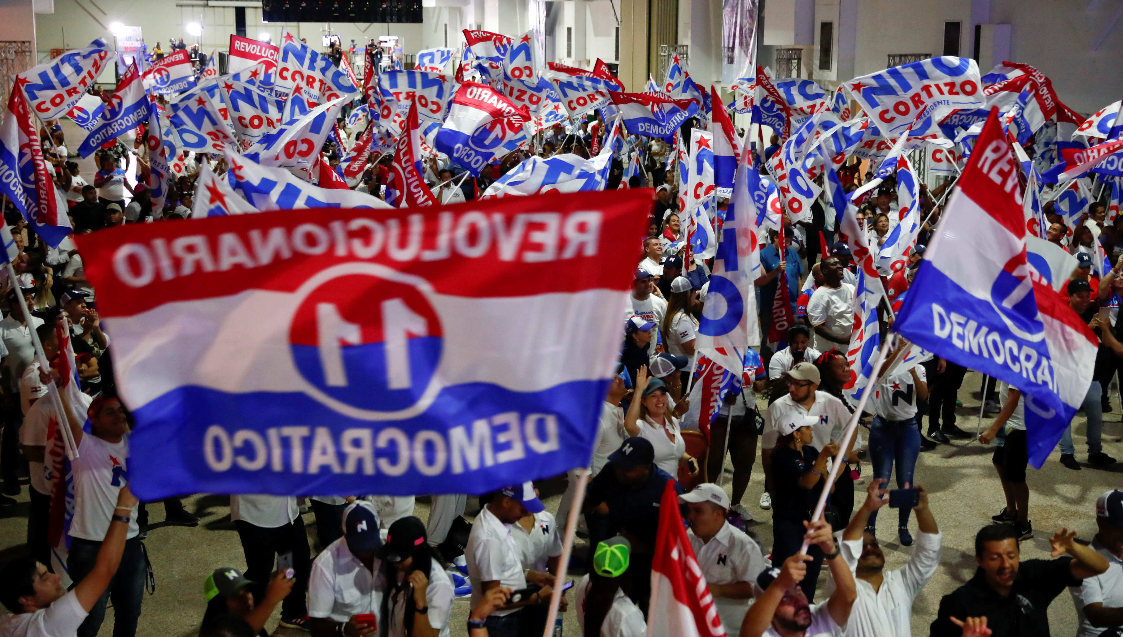 Supporters of presidential candidate Laurentino Cortizo of the Democratic Revolutionary Party (PRD) wave flags as they wait for Cortizo to make an announcement in Panama City, Panama, May 5, 2019.