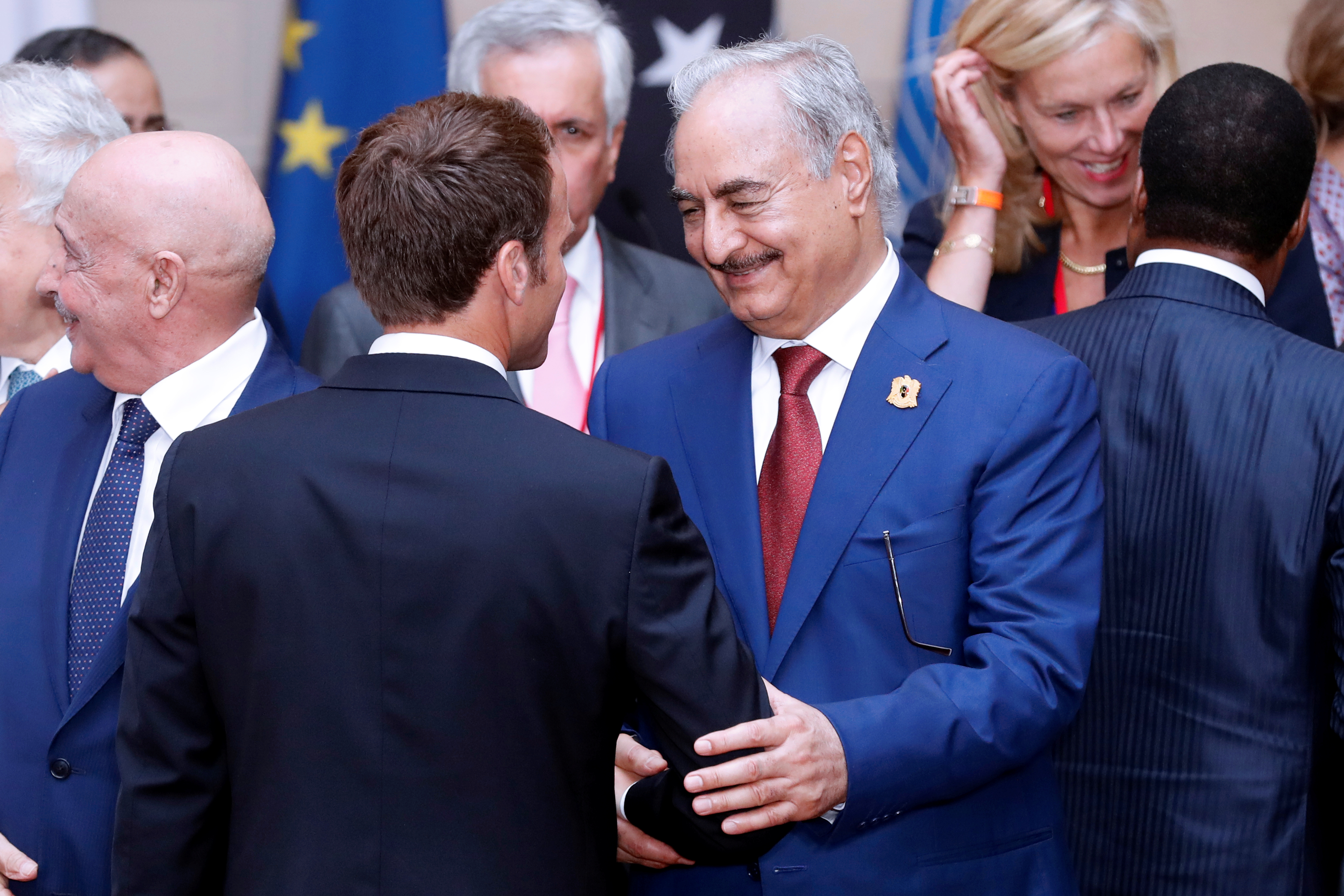 FILE - Khalifa Haftar, the military commander who dominates eastern Libya, shakes hands with French President Emmanuel Macron in Paris, France, May 29, 2018.