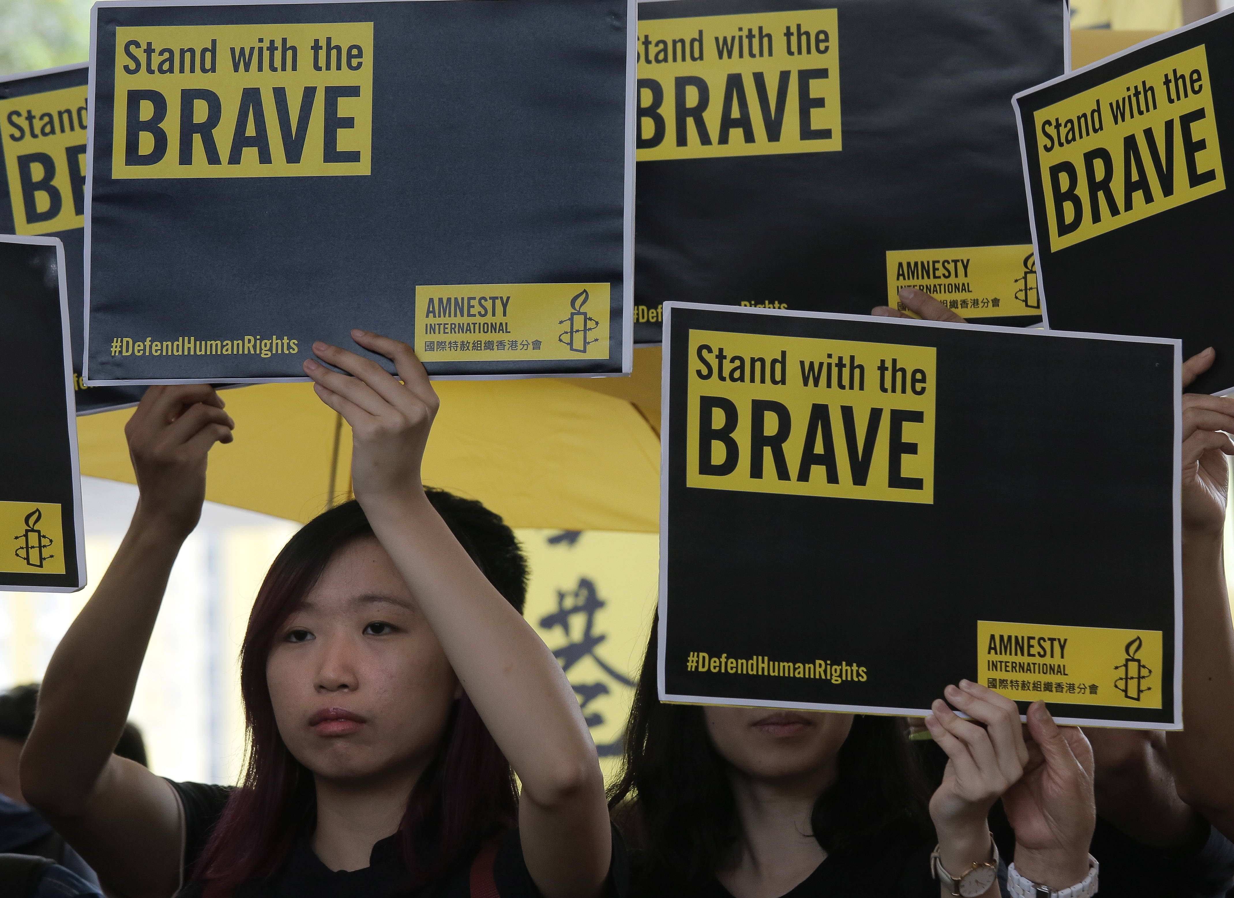 Supporters raise placards outside a court in Hong Kong, April 9, 2019.