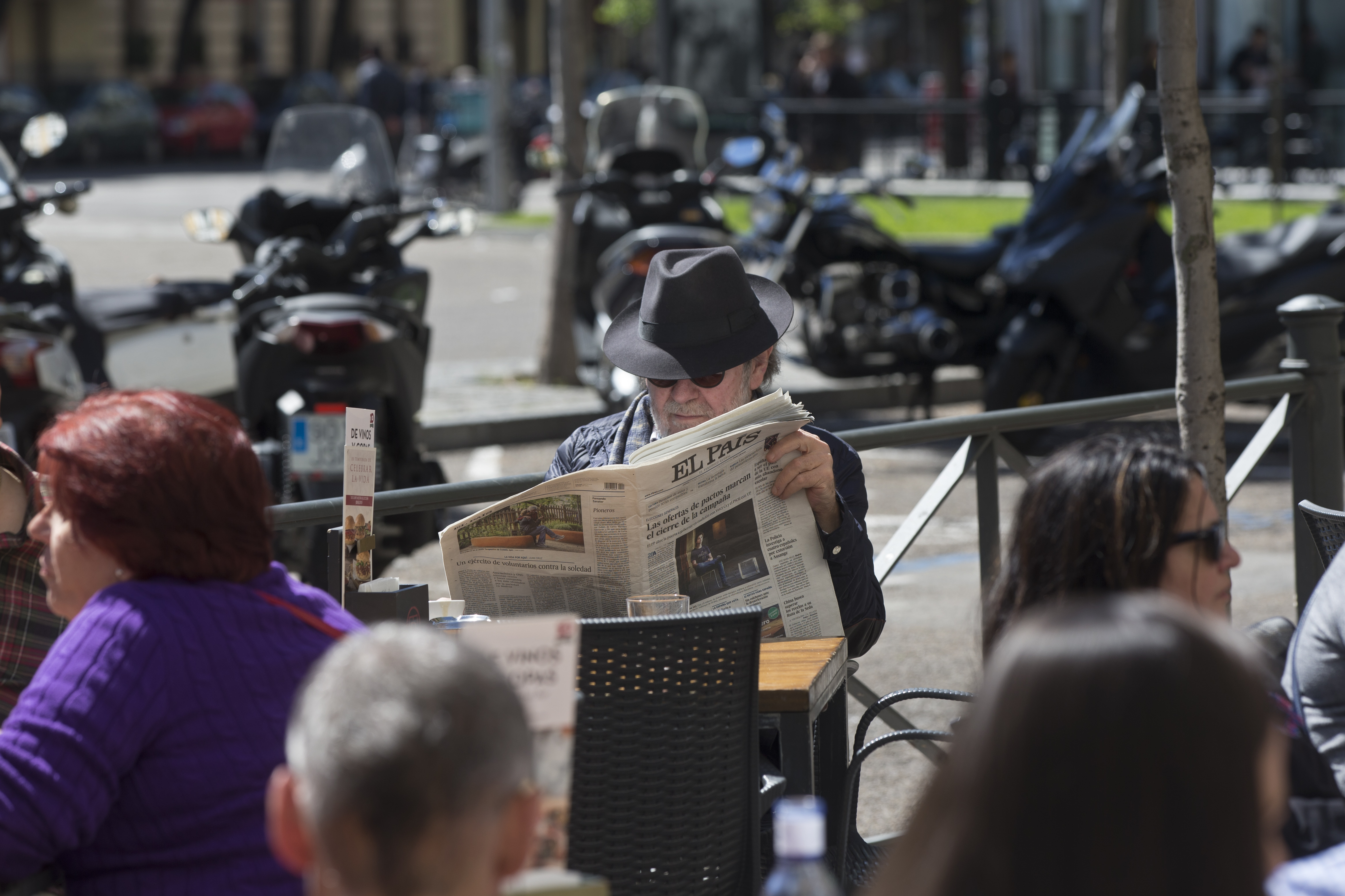 """A man reads a newspaper in a terrace bar on what's called """"The day of Reflection"""" before the general elections, in Madrid, April 27, 2019. Political parties give the public a rest day from their canvassing to relax and ponder before voting Sunday."""