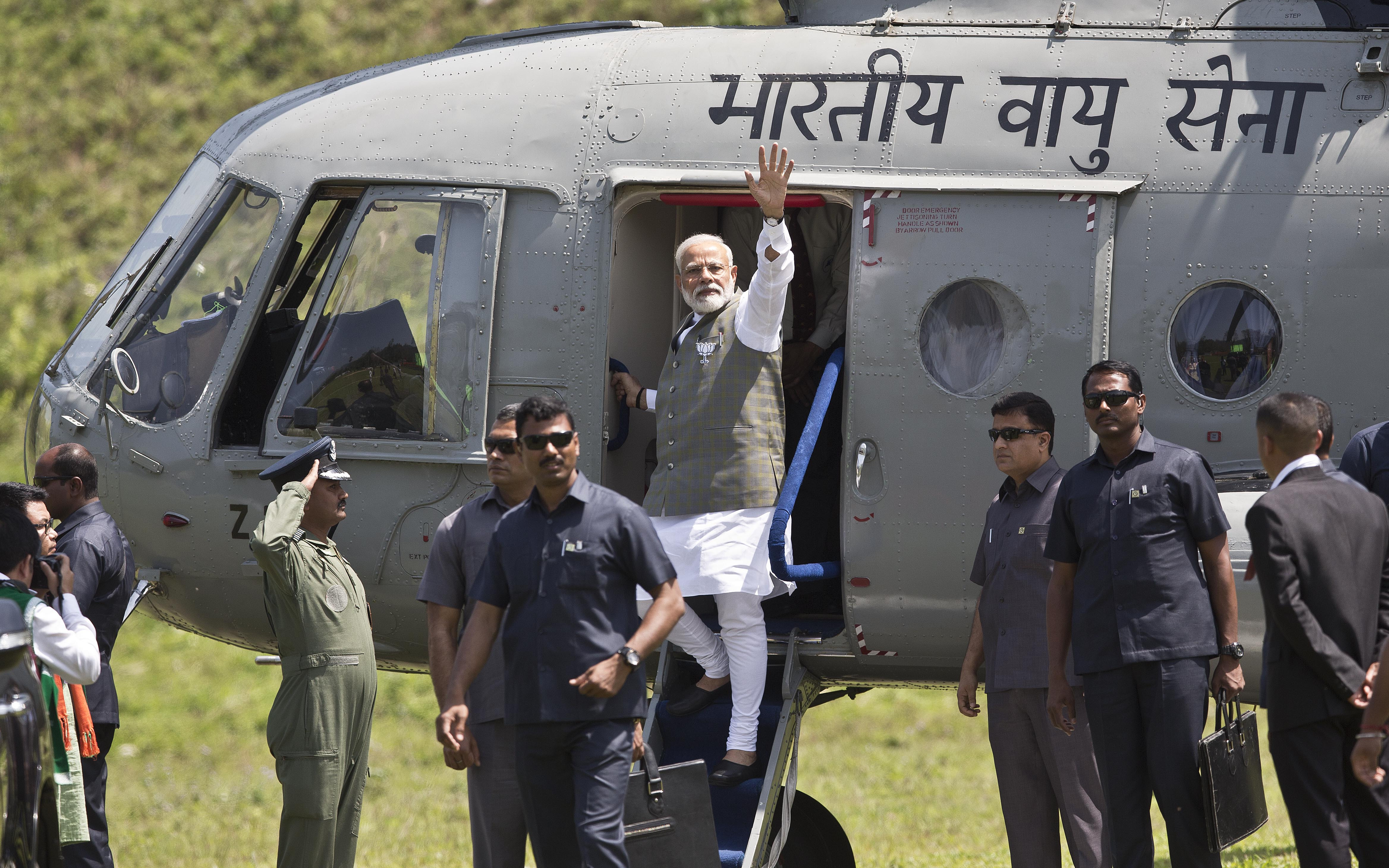 Indian Prime Minister Narendra Modi, center, arrives for an election campaign rally in Along, Arunachal Pradesh, India, March 30, 2019. Poll workers for India's general elections will likely use a helicopter to reach voters in that state.