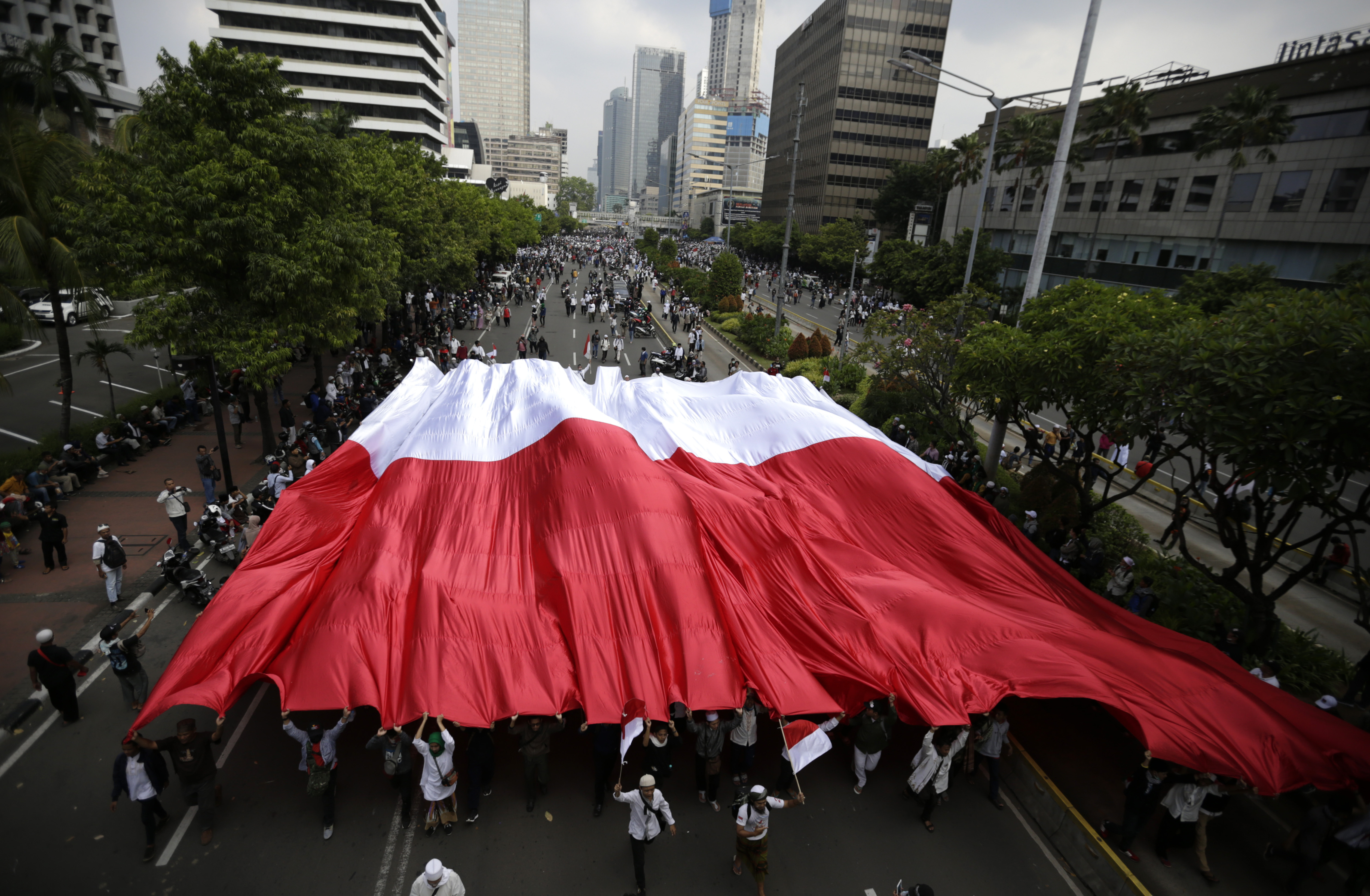 Supporters of Indonesian presidential candidate Prabowo Subianto display a large national Red-White flag during a protest in Jakarta, Indonesia, May 22, 2019.