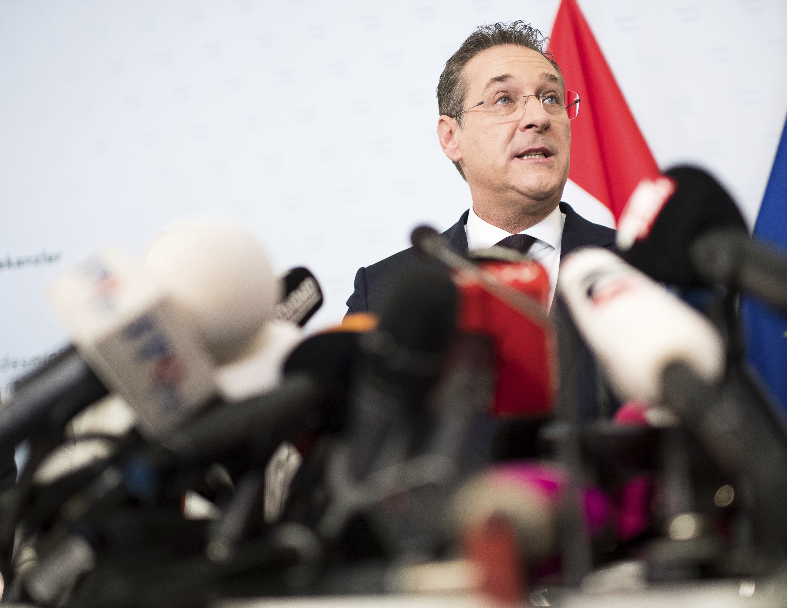 Austrian Vice Chancellor Heinz-Christian Strache, center, addresses the media during press conference at the sport ministry in Vienna, Austria, May 18, 2019.