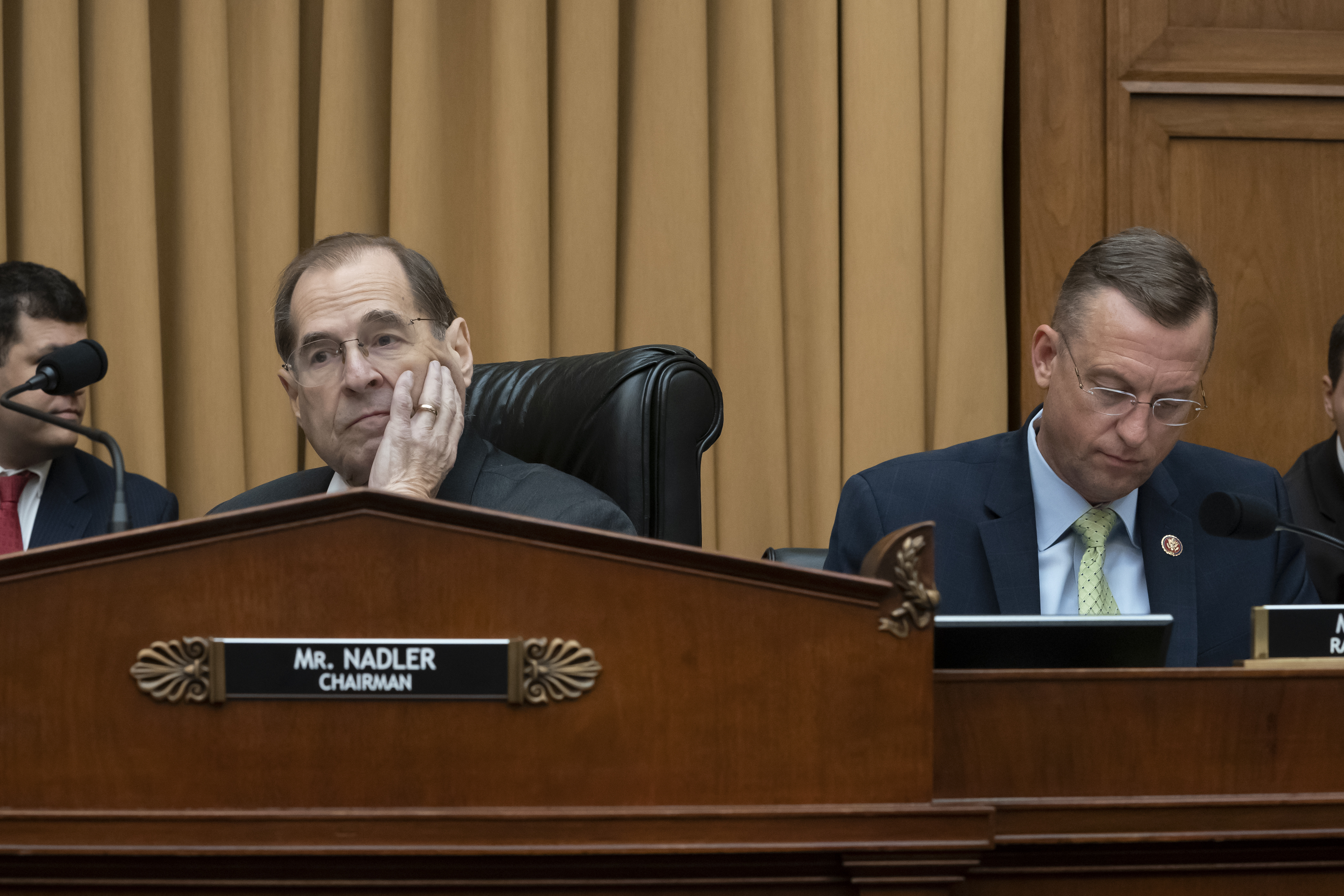 House Judiciary Committee Chair Jerrold Nadler, D-N.Y., joined at right by Rep. Doug Collins, R-Georgia, the ranking member, waits to start a hearing on the Mueller report without witness Attorney General William Barr who refused to appear, May 2, 20...