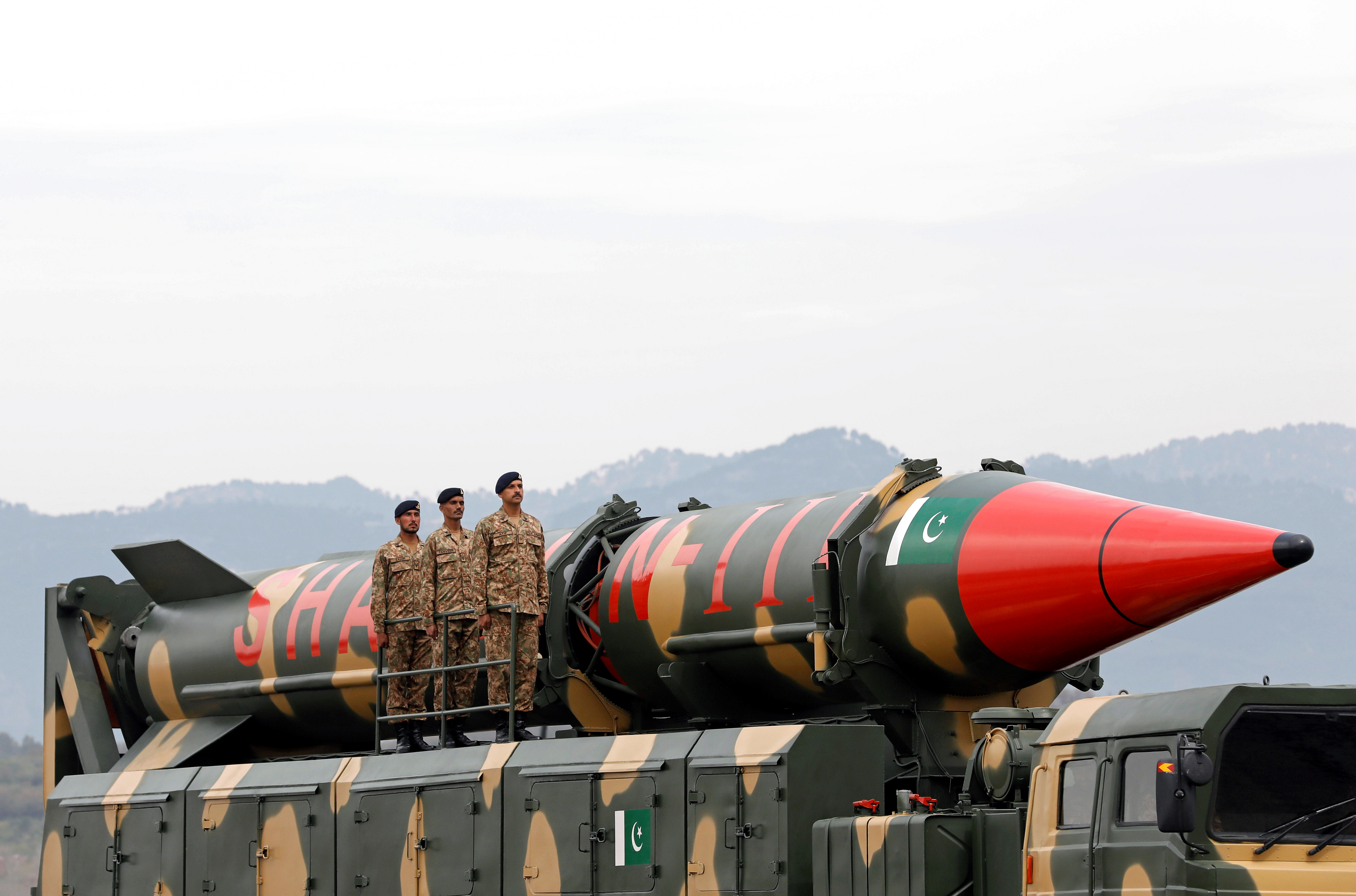 Pakistani military personnel stand beside a Shaheen III surface-to-surface ballistic missile during Pakistan Day military parade in Islamabad, Pakistan, March 23, 2019.