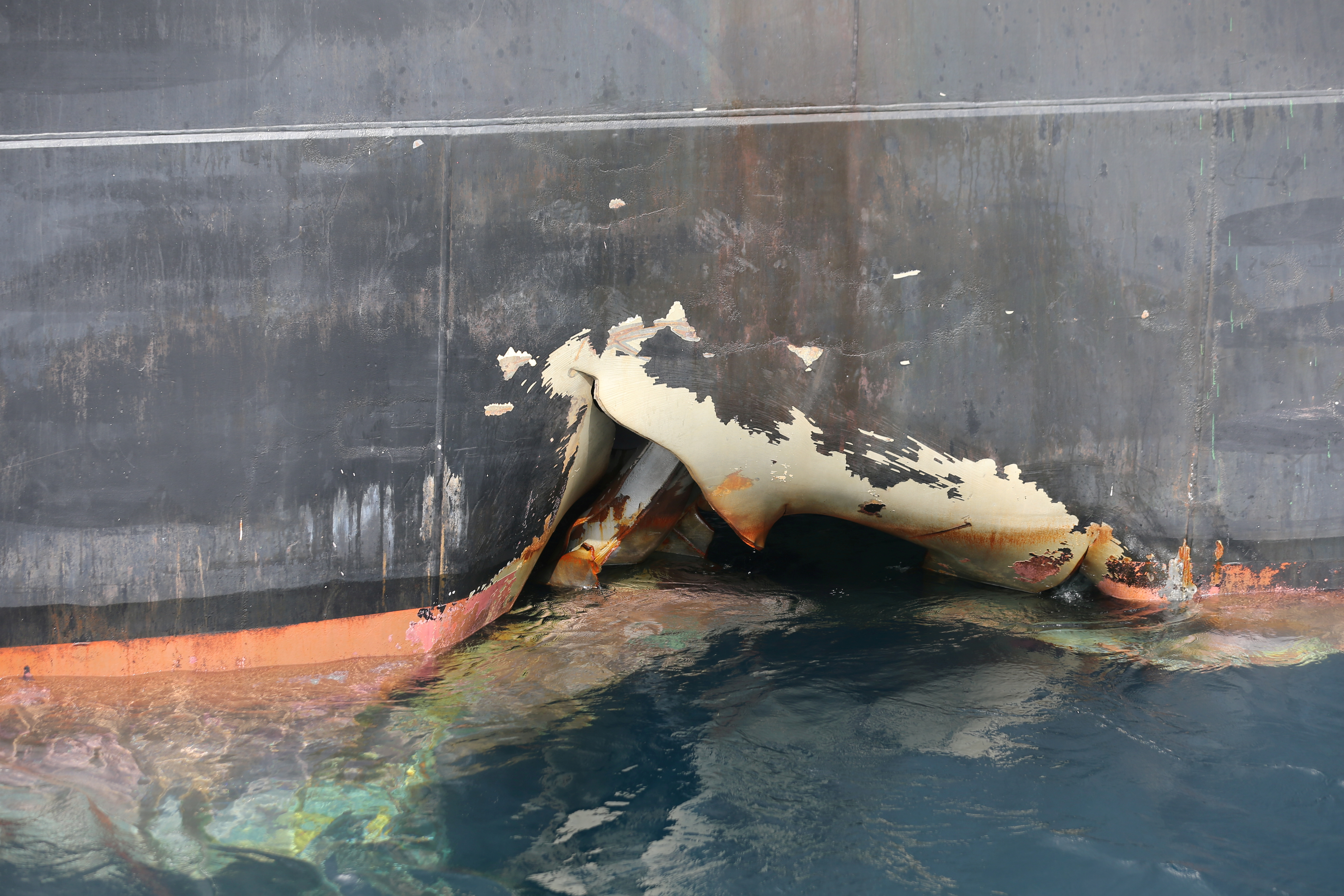 FILE - A damaged Andrea Victory ship is seen off the Port of Fujairah, United Arab Emirates, May 13, 2019.