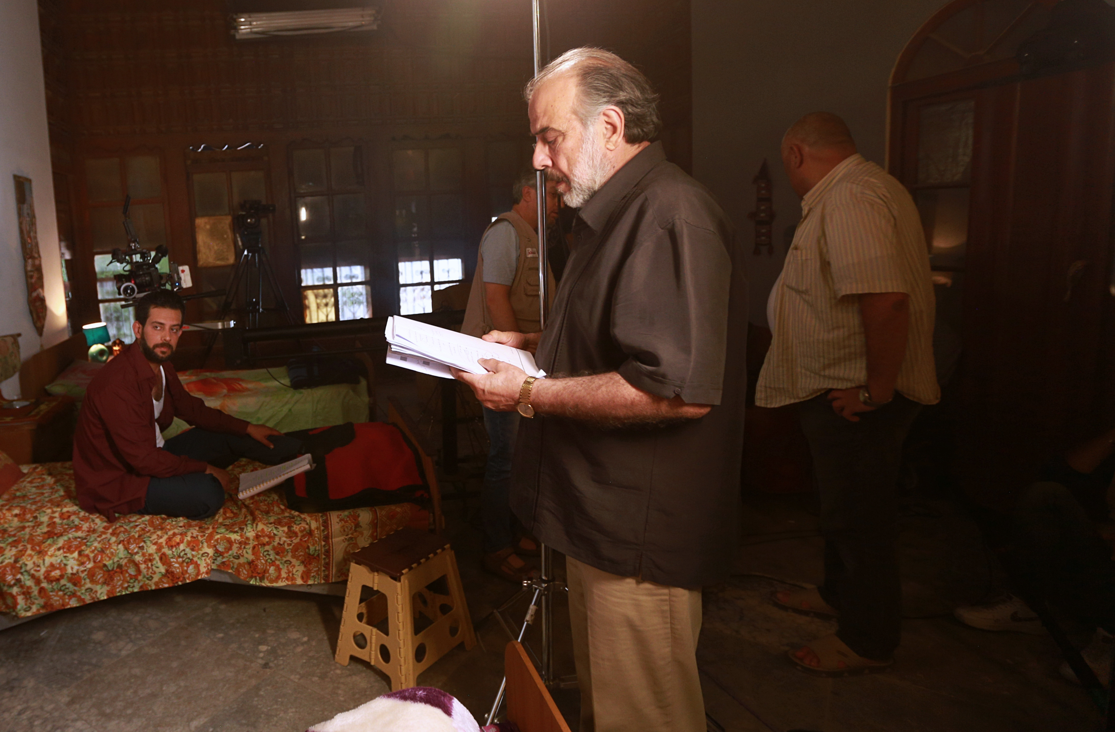 """Iraqi TV drama star Hassan Hosny directs actors in """"The Hotel,"""" on set in Baghdad, April 26, 2019."""
