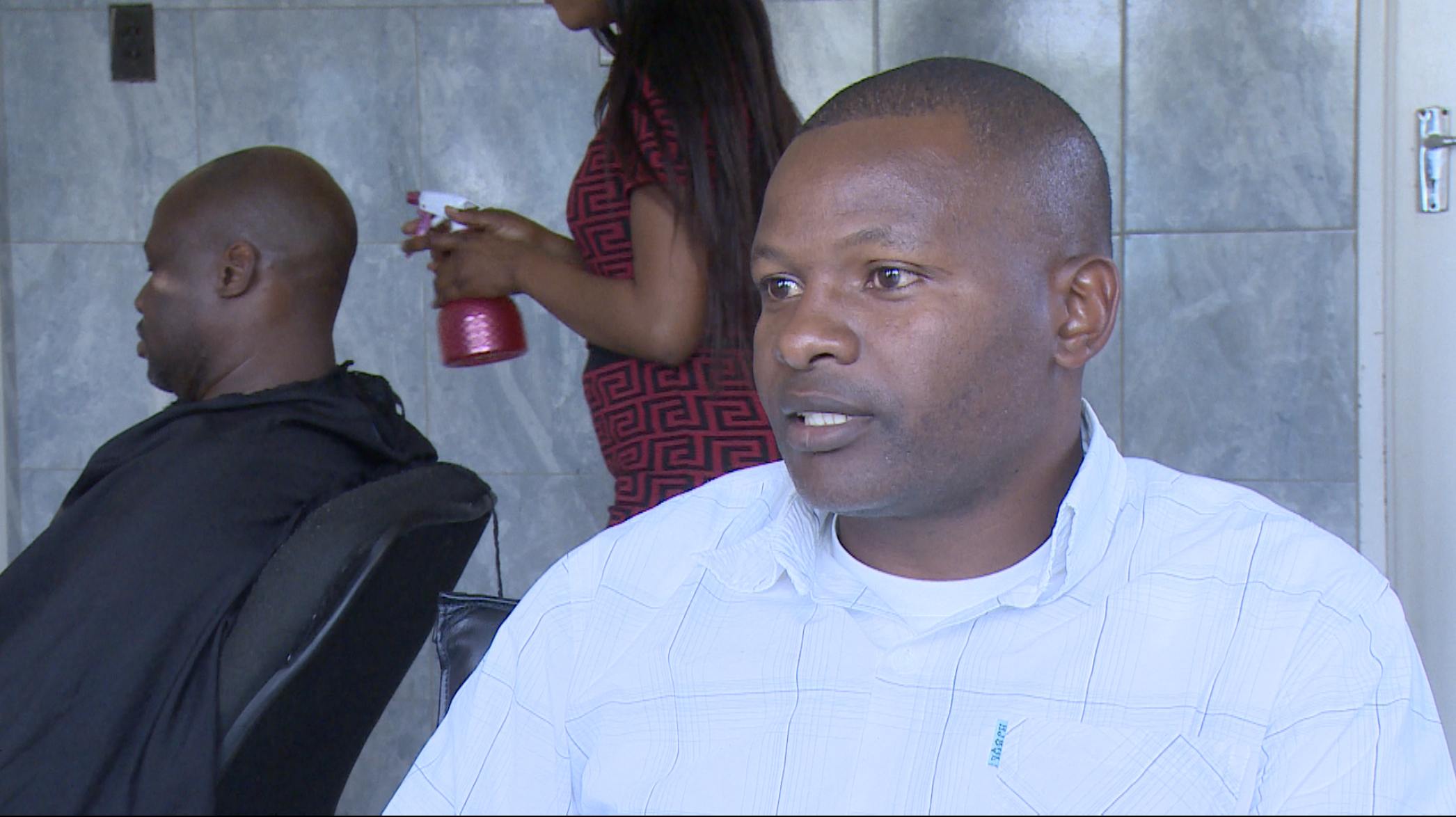 Collins Chigwagwa who runs a small barbershop in a Harare suburb, last week bought a solar power system that he says can power his shop for up to eight hours to reduce the impact of Zimbabwe's lengthy power cuts (C. Mavhunga/VOA)