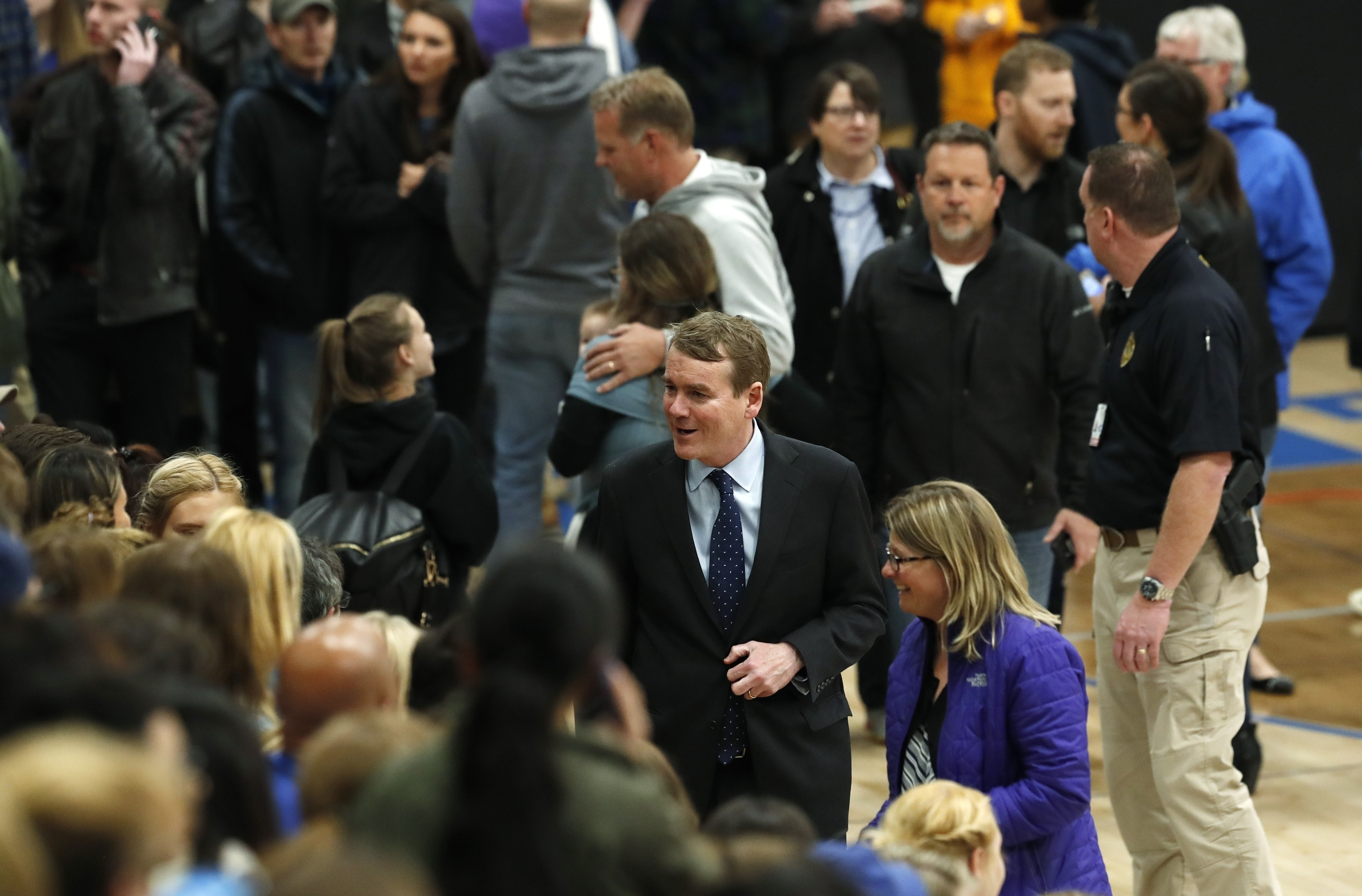 U.S. Sen. Michael Bennet, D-Colo., center, greets attendees during a community vigil to honor the victims and survivors of yesterday's fatal shooting at the STEM School Highlands Ranch, May 8, 2019, in Highlands Ranch, Colorado.
