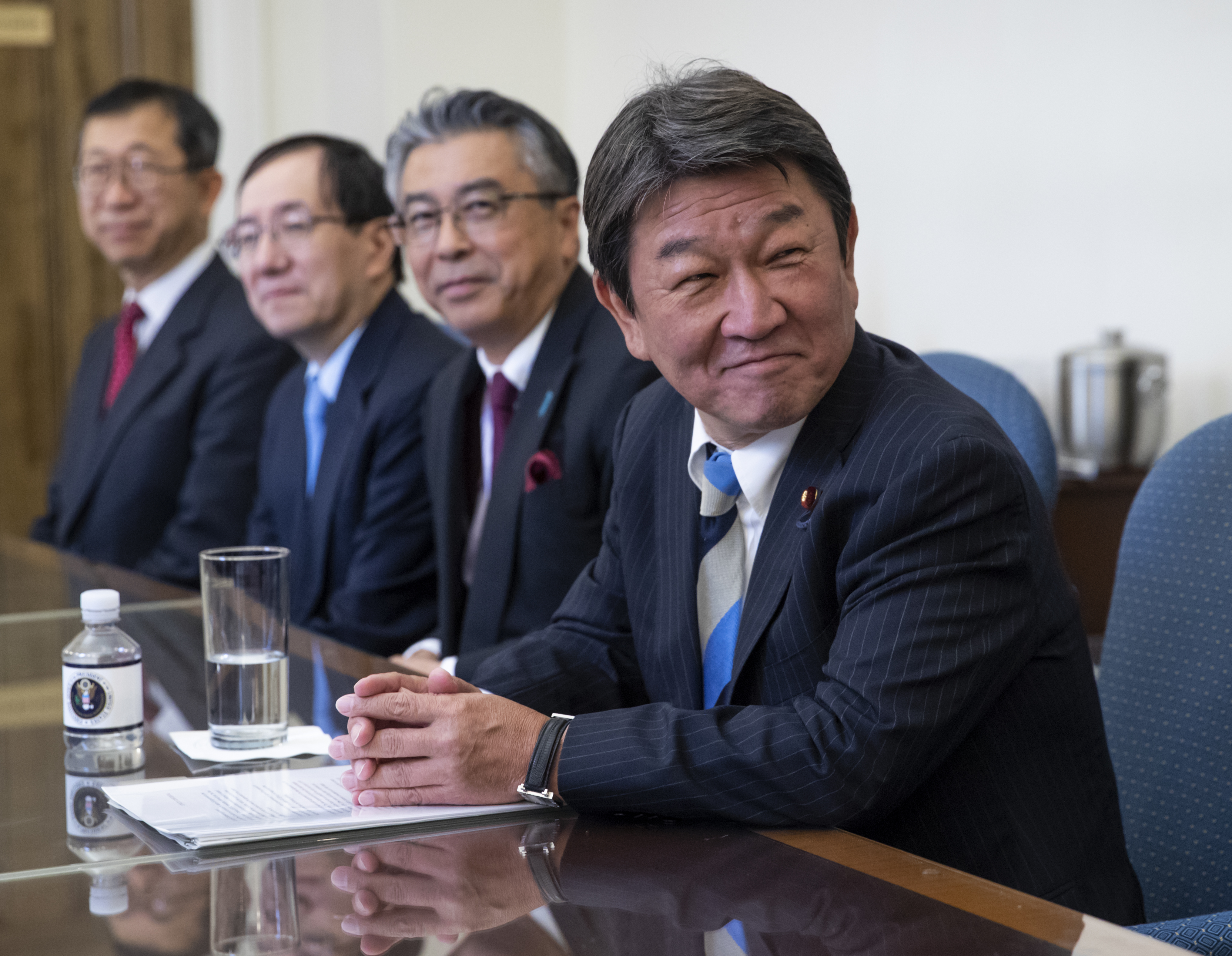 FILE - Toshimitsu Motegi, Japan's minister of economy, trade and industry, smiles as he and U.S. Trade Representative Robert Lighthizer begin ministerial trade talks, at the Office of the U.S. Trade Representative in Washington, Aug. 9, 2018.
