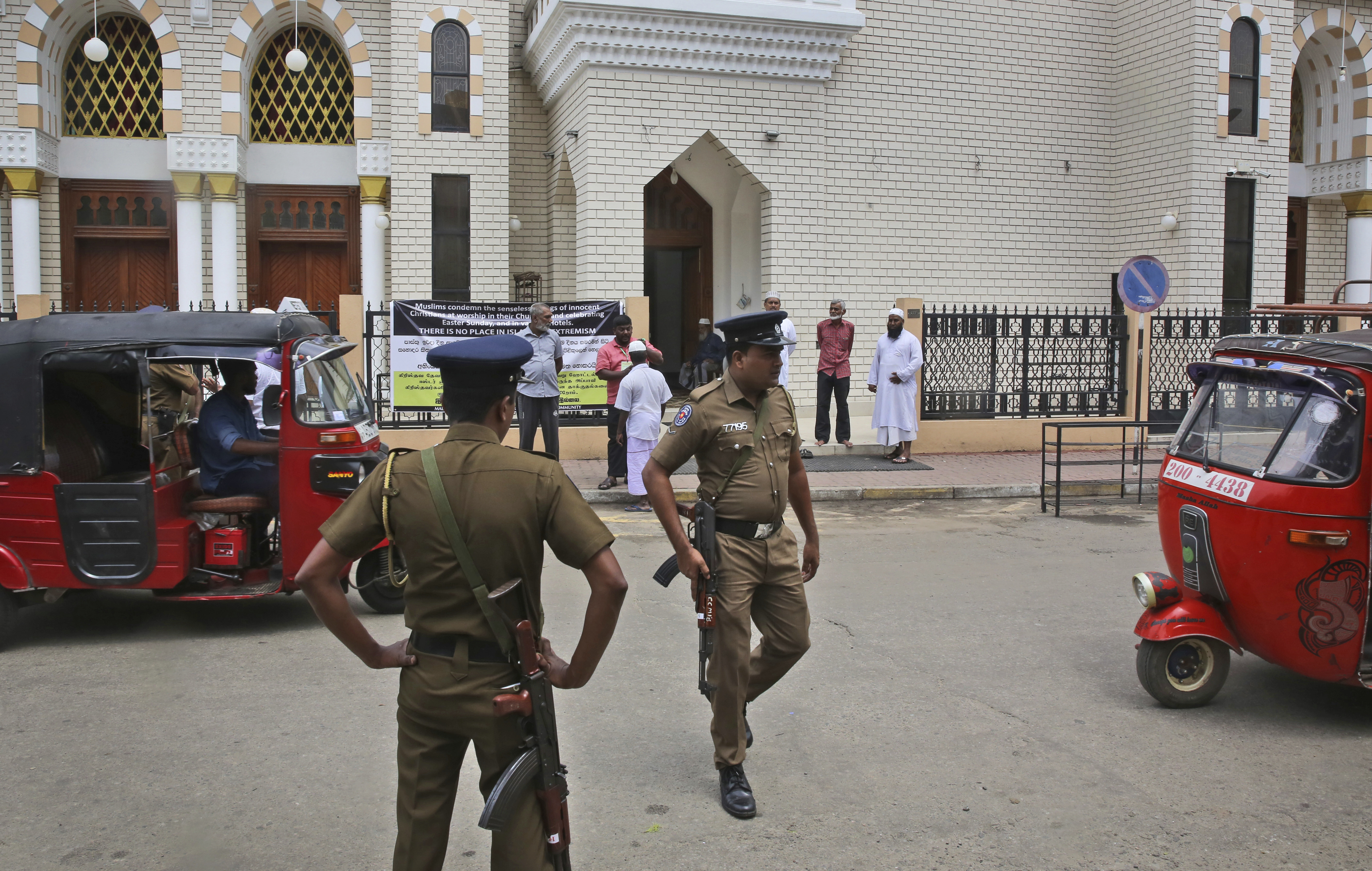 Sri Lankan policemen stand guard outside a mosque before the Friday prayers, in Colombo, Sri Lanka, April 26, 2019.