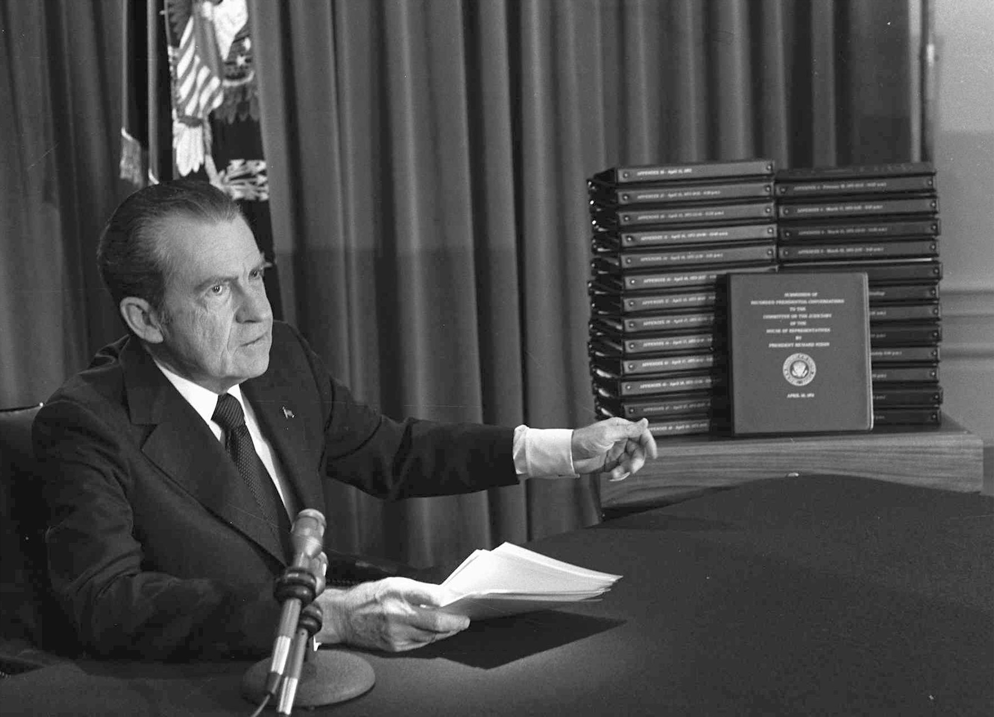 FILE - President Richard M. Nixon is shown pointing to the transcripts of the White House tapes in this April 29, 1974 photo, after he announced during a nationally-televised speech that he would turn over the transcripts to House impeachment invesig...