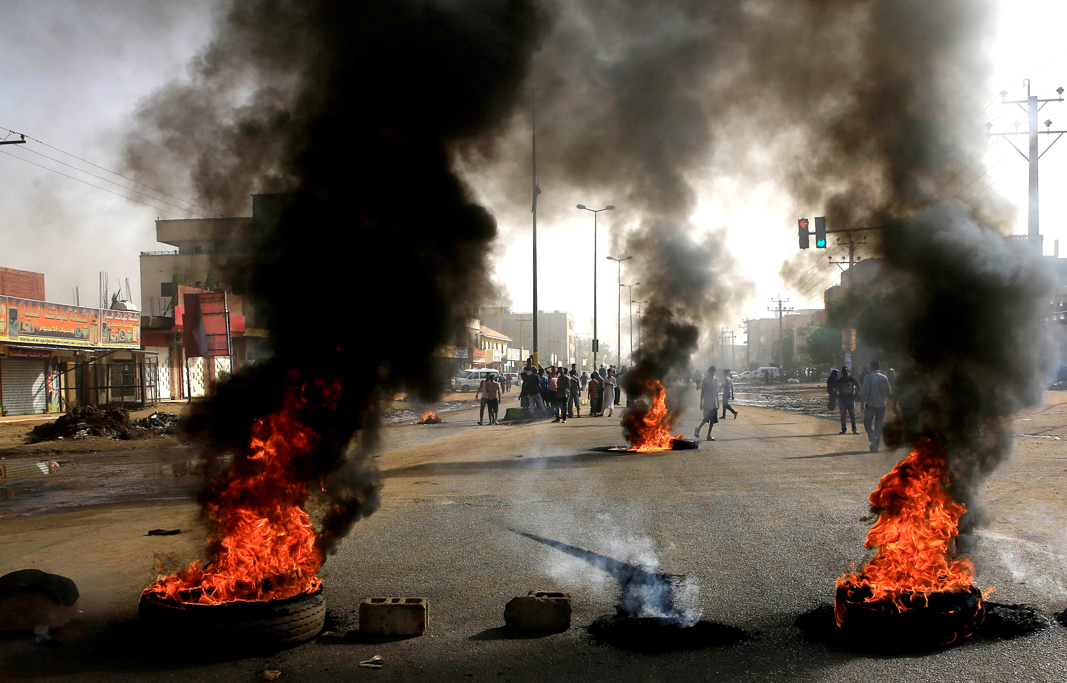 Sudanese protesters use burning tires to erect a barricade on a street, demanding that the country's Transitional Military Council hand over power to civilians, in Khartoum, Sudan, June 3, 2019.