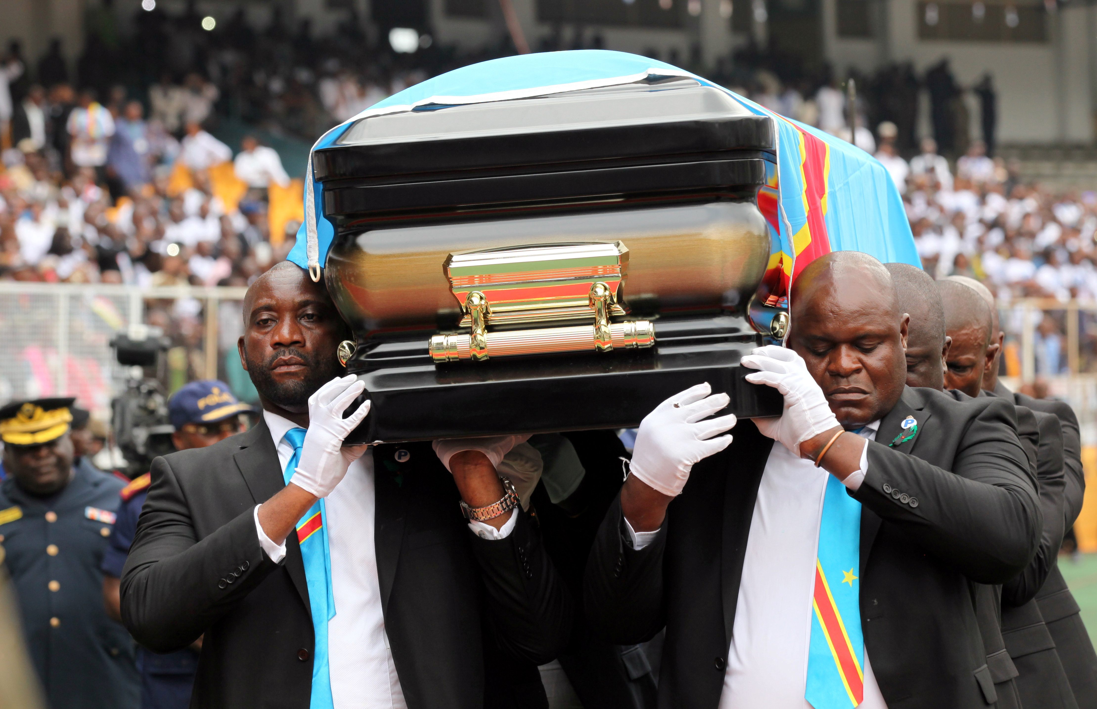 Pallbearers carry the casket with the remains of Etienne Tshisekedi, former Congolese opposition figure who died in Belgium two years ago, at the Martyrs of Pentecost Stadium in Kinshasa, Democratic Republic of Congo May 31, 2019.