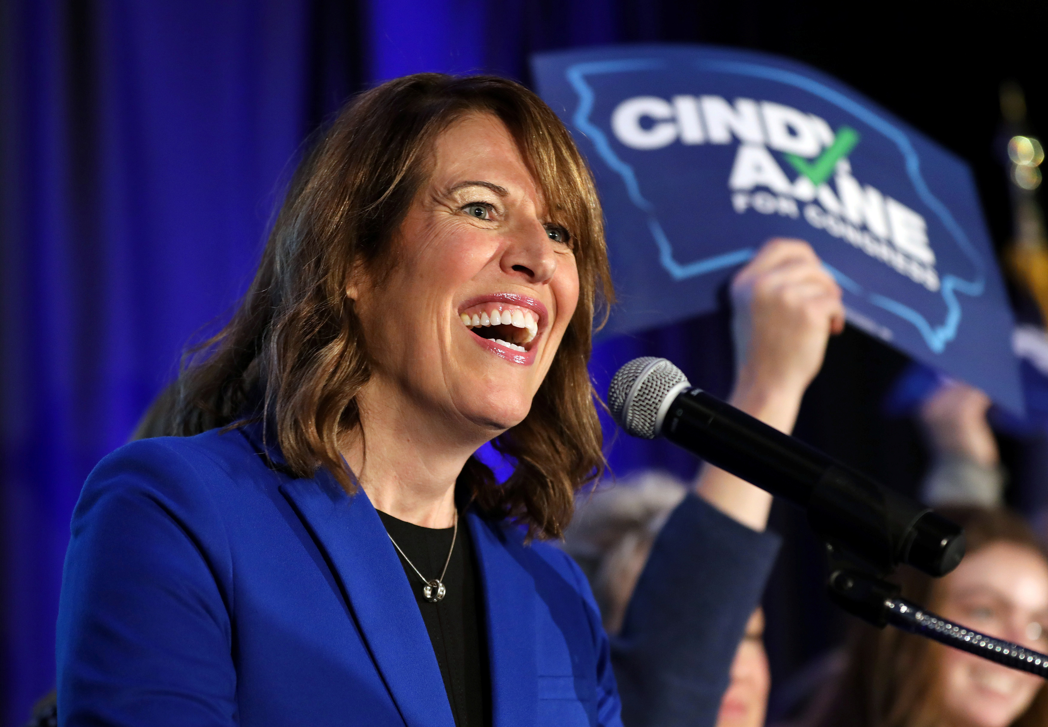 FILE - Democratic congressional candidate Cindy Axne reacts while appearing at her midterm election night party in Des Moines, Iowa, Nov. 6, 2018.