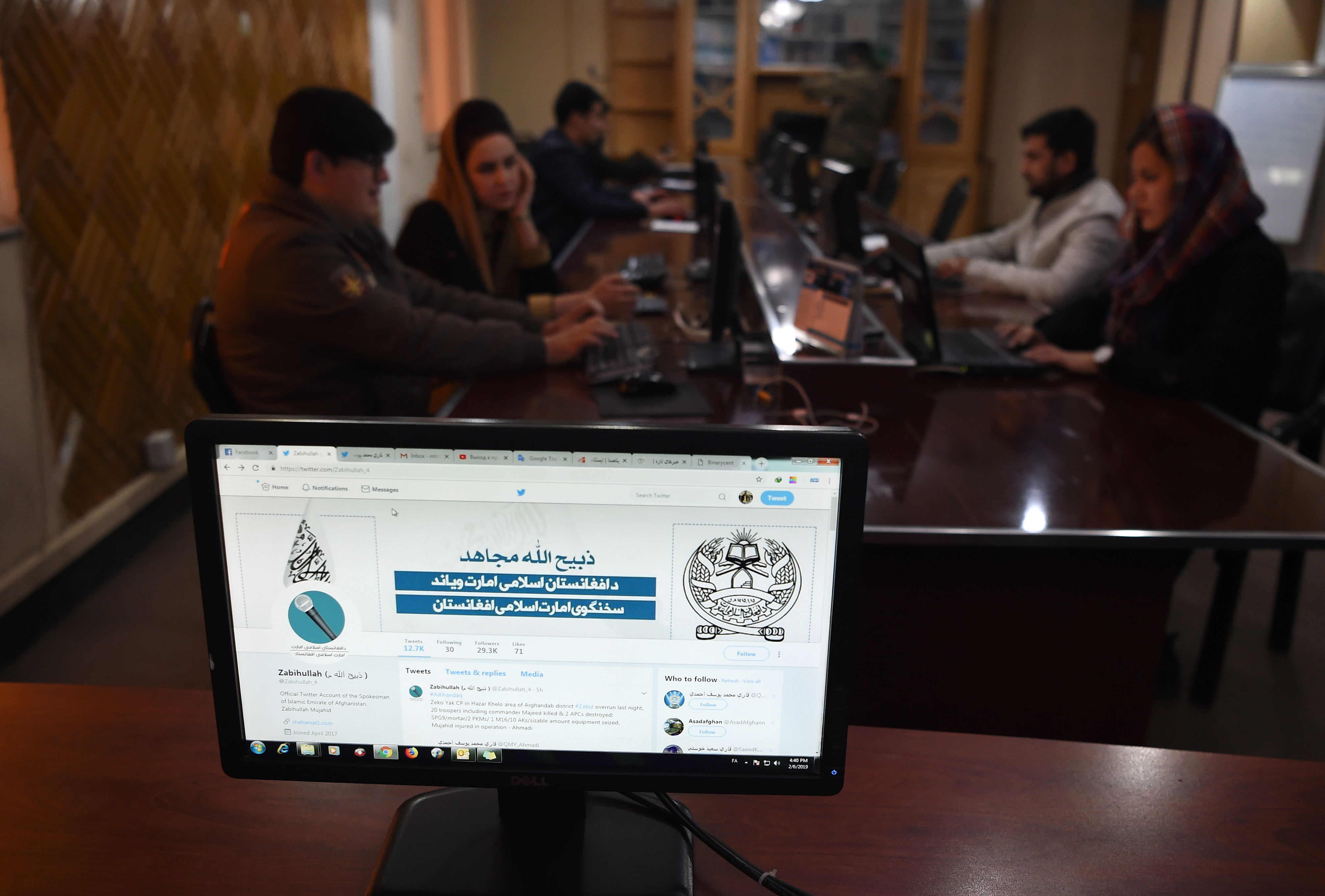 In this photo taken on Feb. 6, 2019, the Twitter page of Taliban spokesman Zabihullah Mujahid is pictured on a computer monitor in the newsroom at Maiwand TV station in Kabul.
