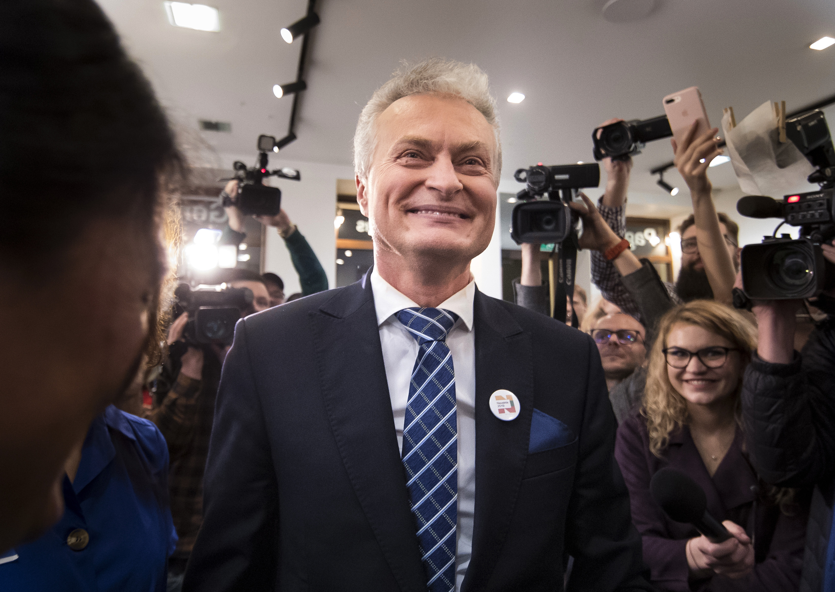 Economist Gitanas Nauseda, a presidential candidate, celebrates winning the first round of Lithuania's presidential election in office in Vilnius, Lithuania, early Monday, May 13, 2019.