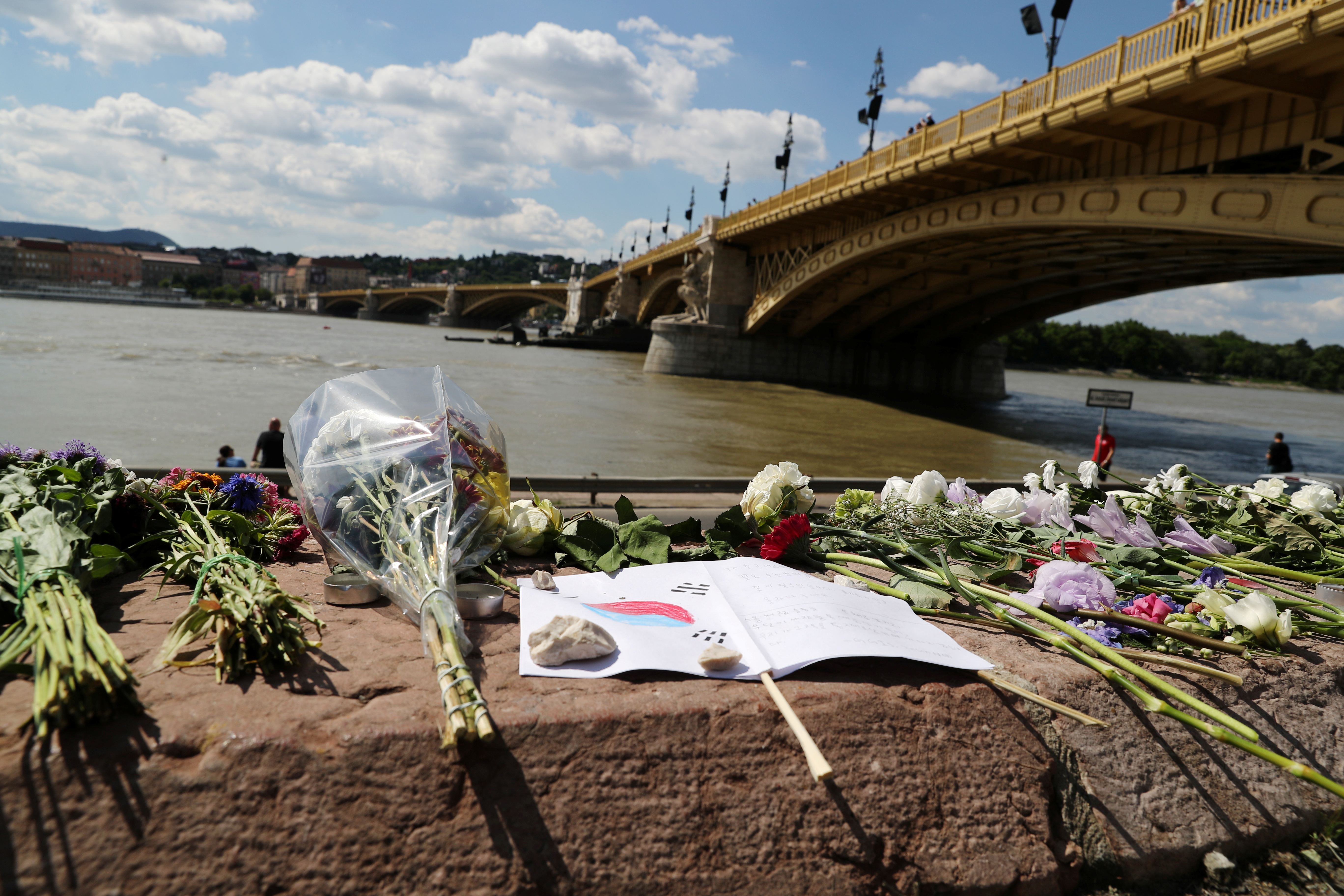 Flowers are placed next to the Margaret bridge in respect for the victims of a boating accident on the Danube river, in Budapest, Hungary, June 1, 2019.