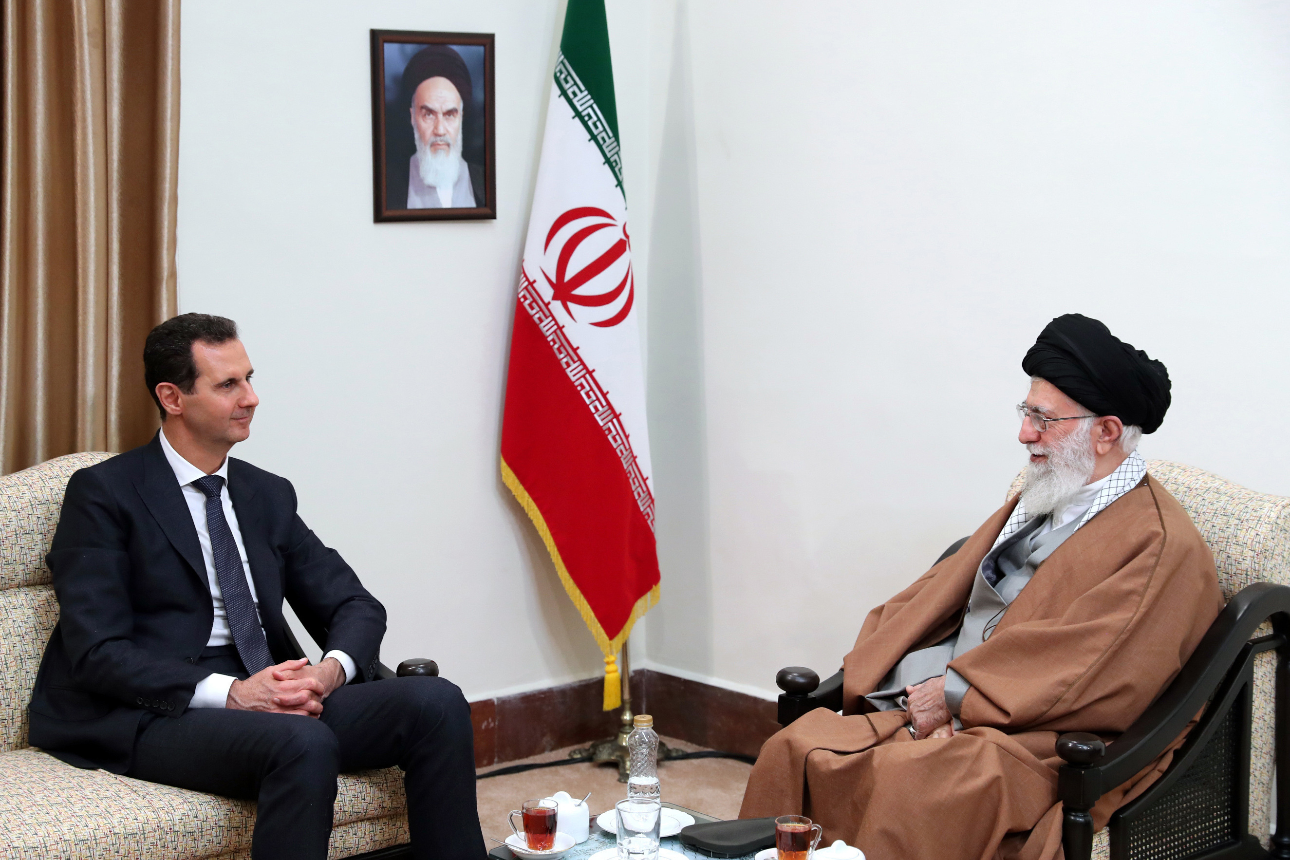 FILE - In this photo released by an official website of the office of the Iranian supreme leader, Supreme Leader Ayatollah Ali Khamenei, right, speaks with Syrian President Bashar al-Assad during their meeting in Tehran, Iran, Feb. 25, 2019.