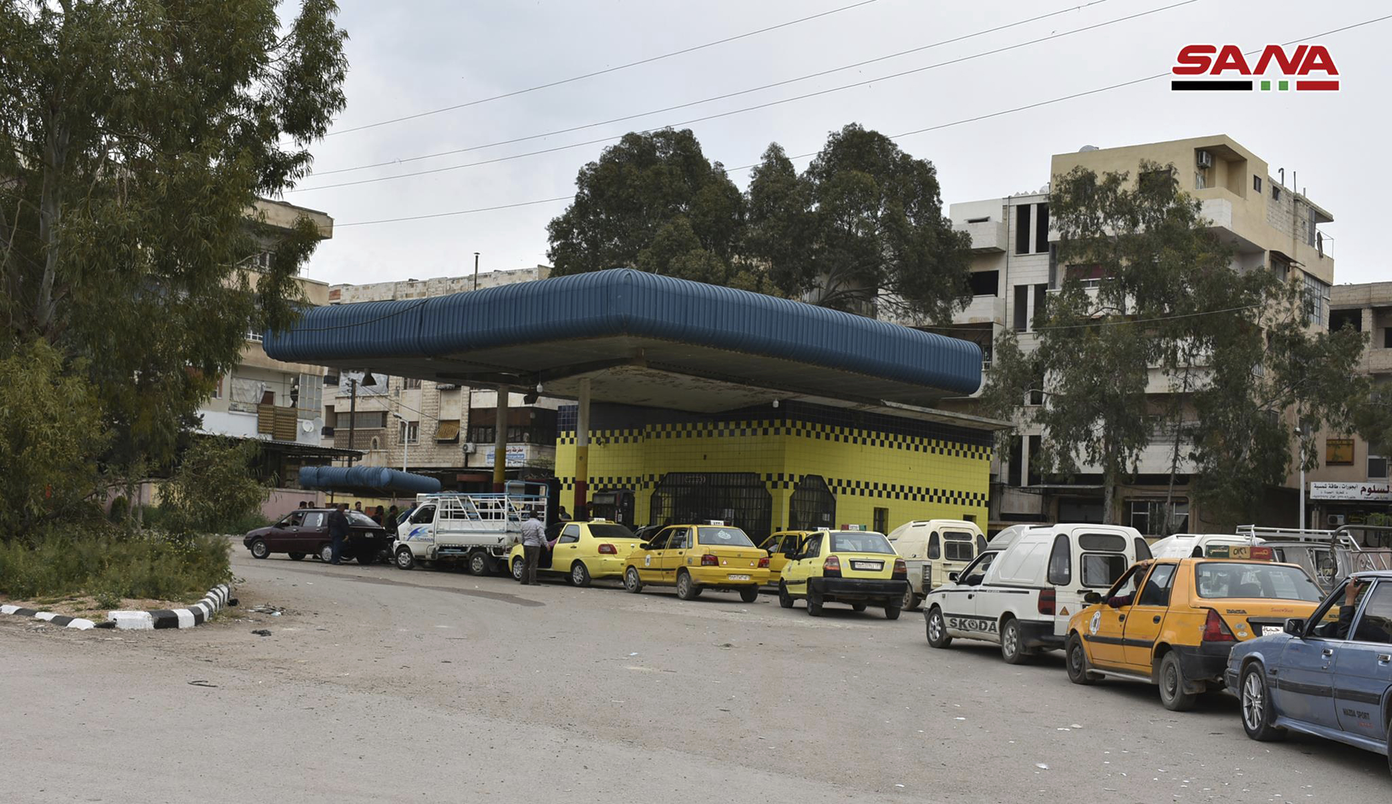 This file photo released on April 7, 2019, by the Syrian official news agency SANA, shows cars queuing to fill their tanks with fuel, at a gas station in Daraa, south Syria.