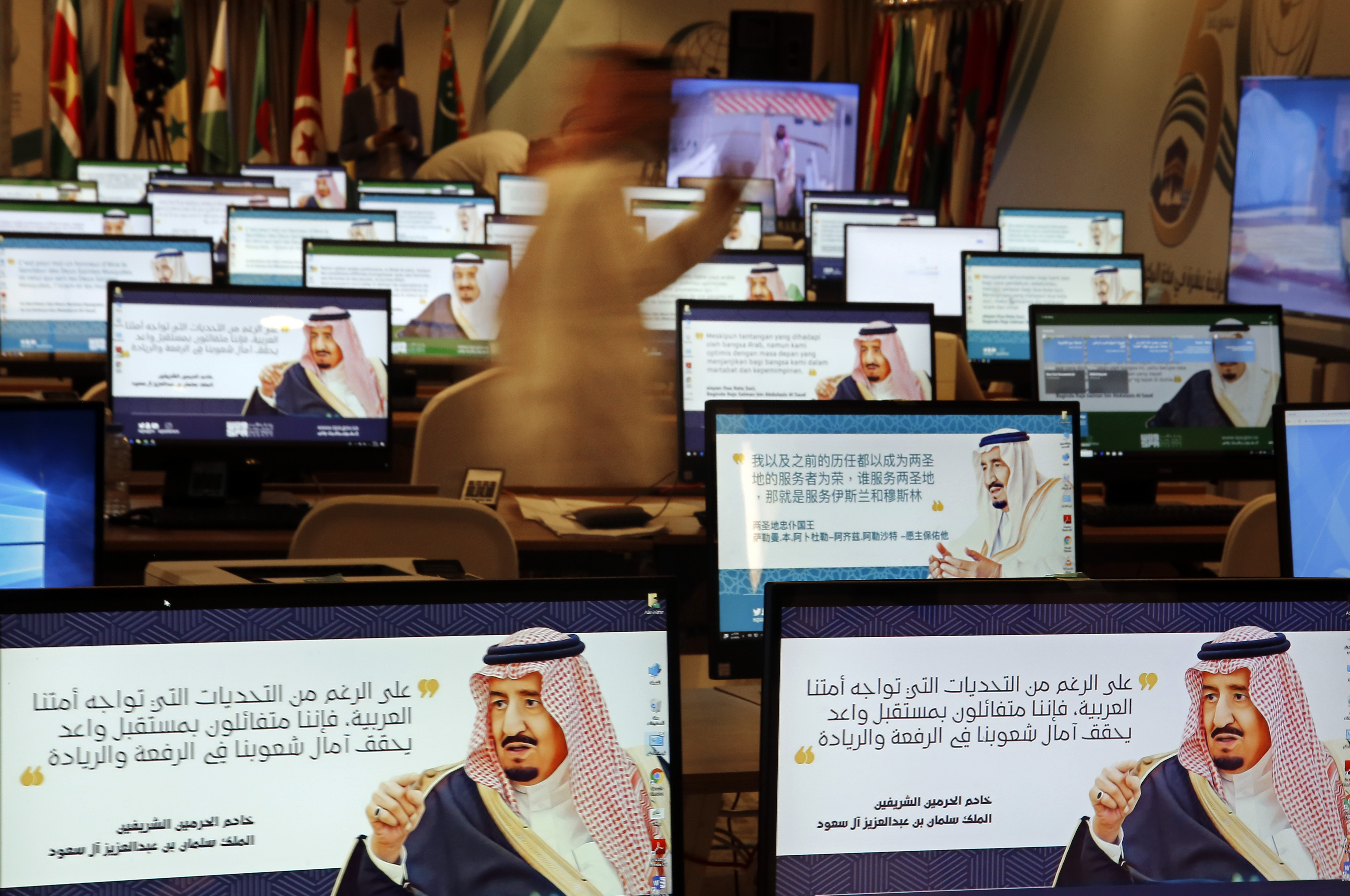 Screensavers showing King Salman are visible on computers at the press center for upcoming summits, in Mecca, Saudi Arabia, May 30, 2019.