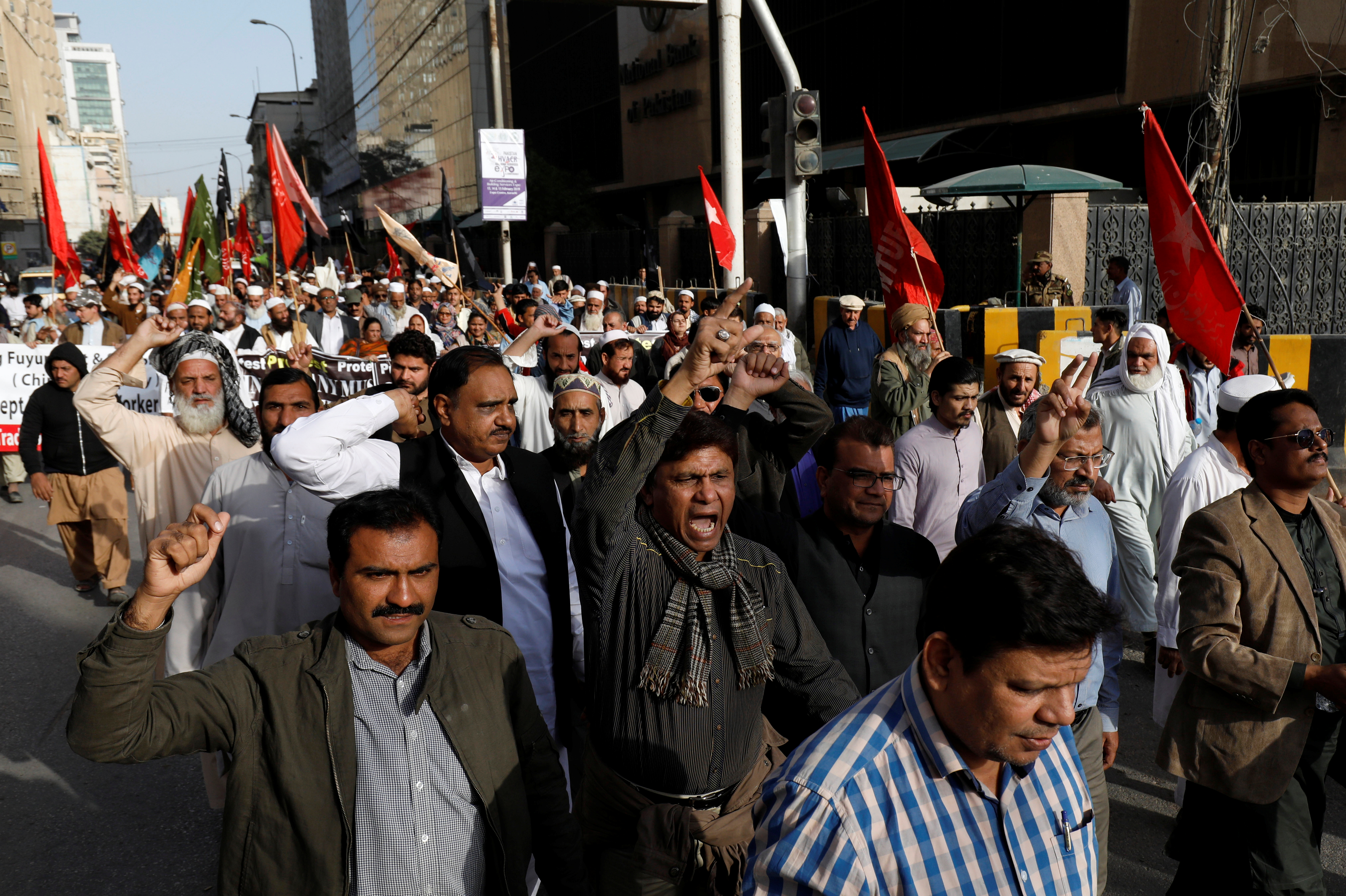 Journalists and social activists chant slogans during a rally protest which they say is against layoffs and the non-payment of salaries, in Karachi, Pakistan Feb. 8, 2019.