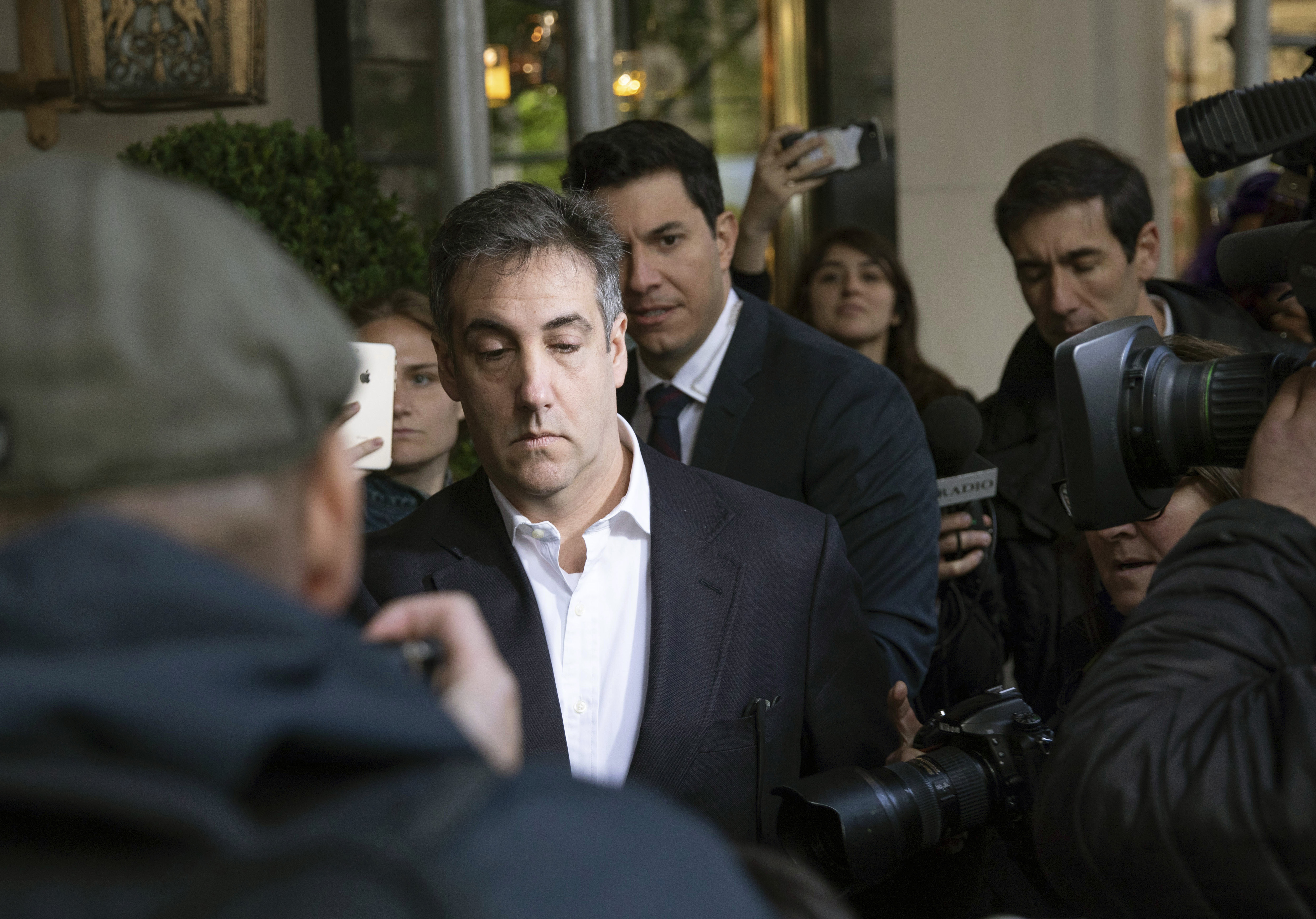 Michael Cohen, former attorney to President Donald Trump, leaves his apartment building before beginning his prison term, May 6, 2019, in New York.