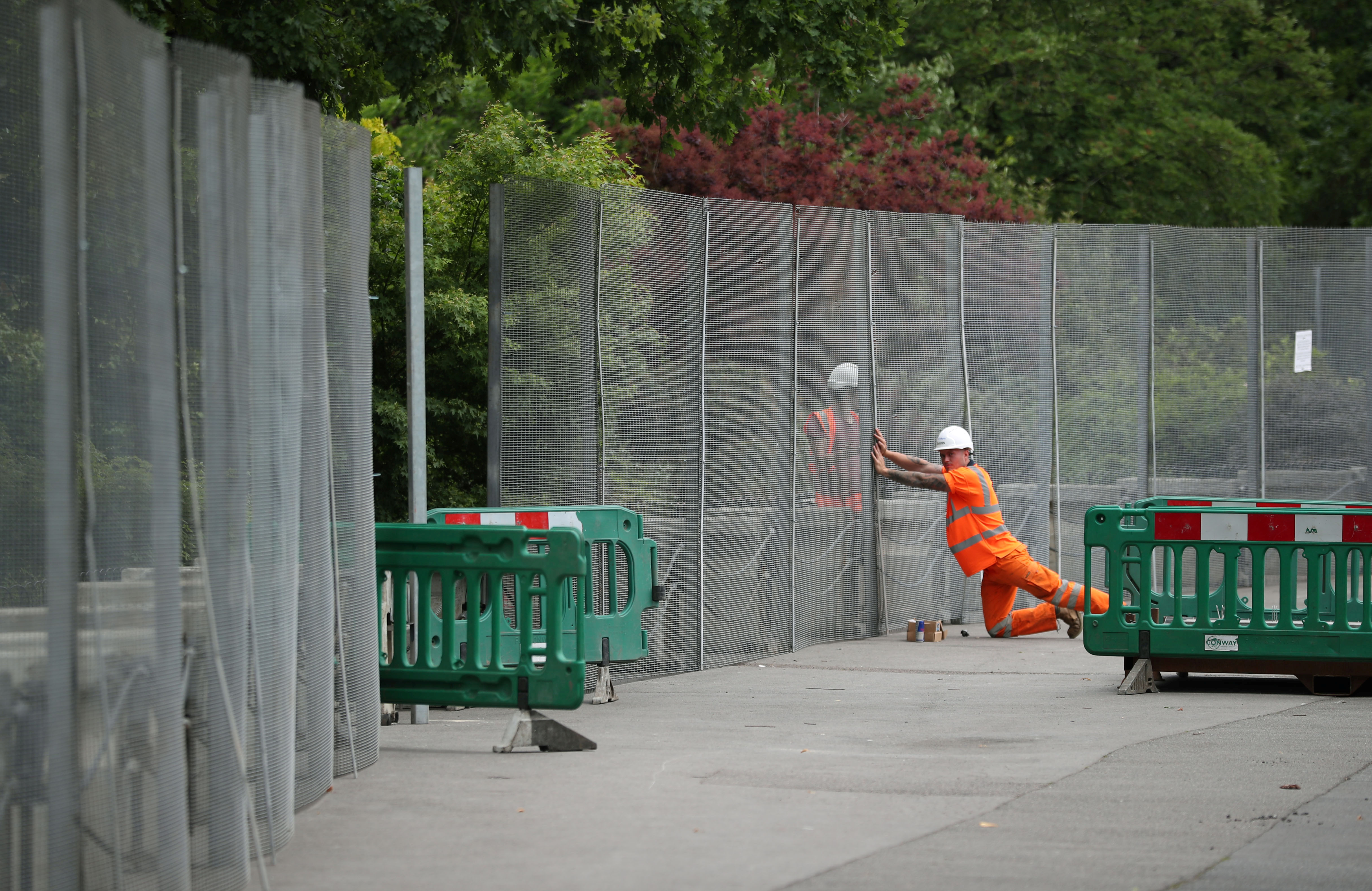 Workmen construct fences ahead of the U.S. presidential visit, around the U.S. ambassador's residence in Regent's Park in London, May 31, 2019.