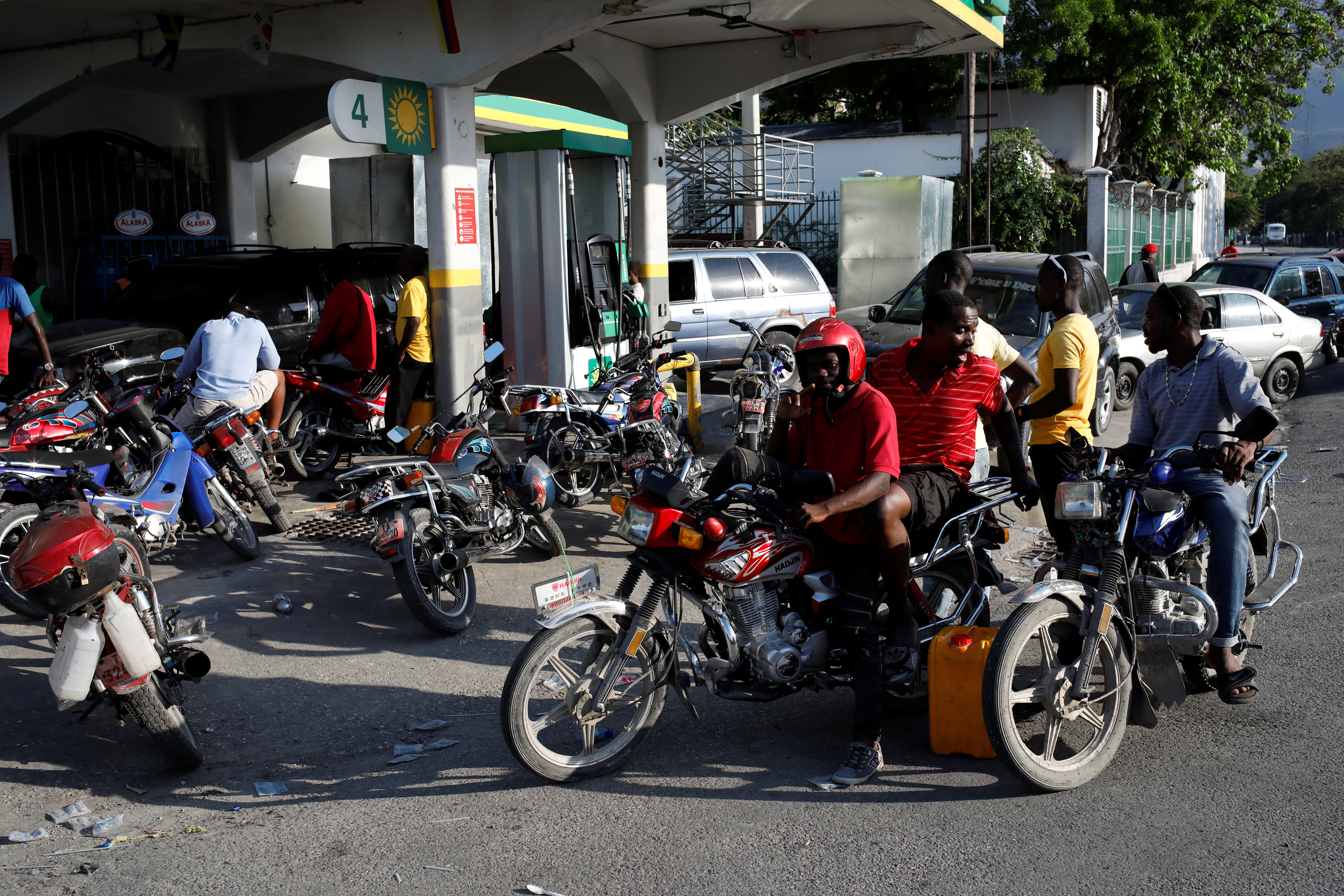 Motorbike and car drivers wait to get fuel at a gas station in Port-au-Prince, Haiti, April 7, 2019. Picture taken April 7, 2019.