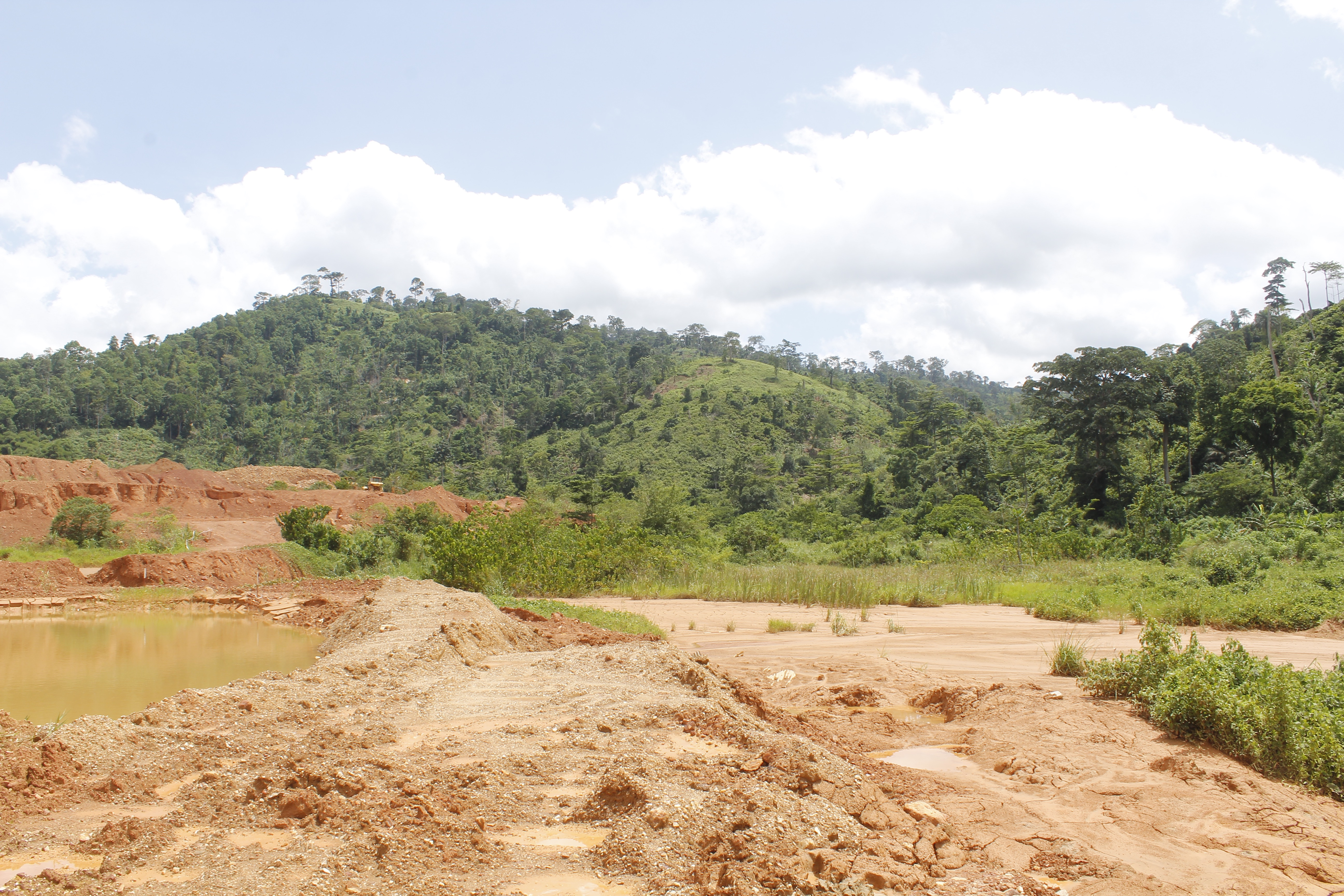 Toxic sludge split over from a dam at a small-scale mining site in southeastern Ghana, May 23, 2019.