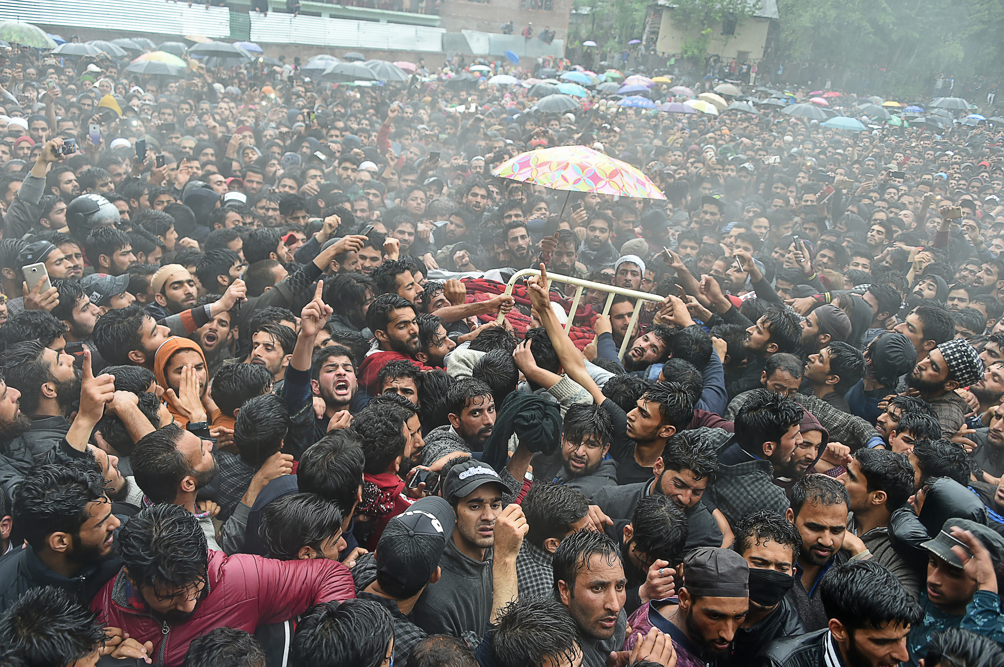 Kashmiri villagers carry a body of top militant commander Zakir Musa of Ansar Ghazwat-ul-Hind group during a funeral procession at Dadsar village in Tral, south of Srinagar, May 24, 2019.
