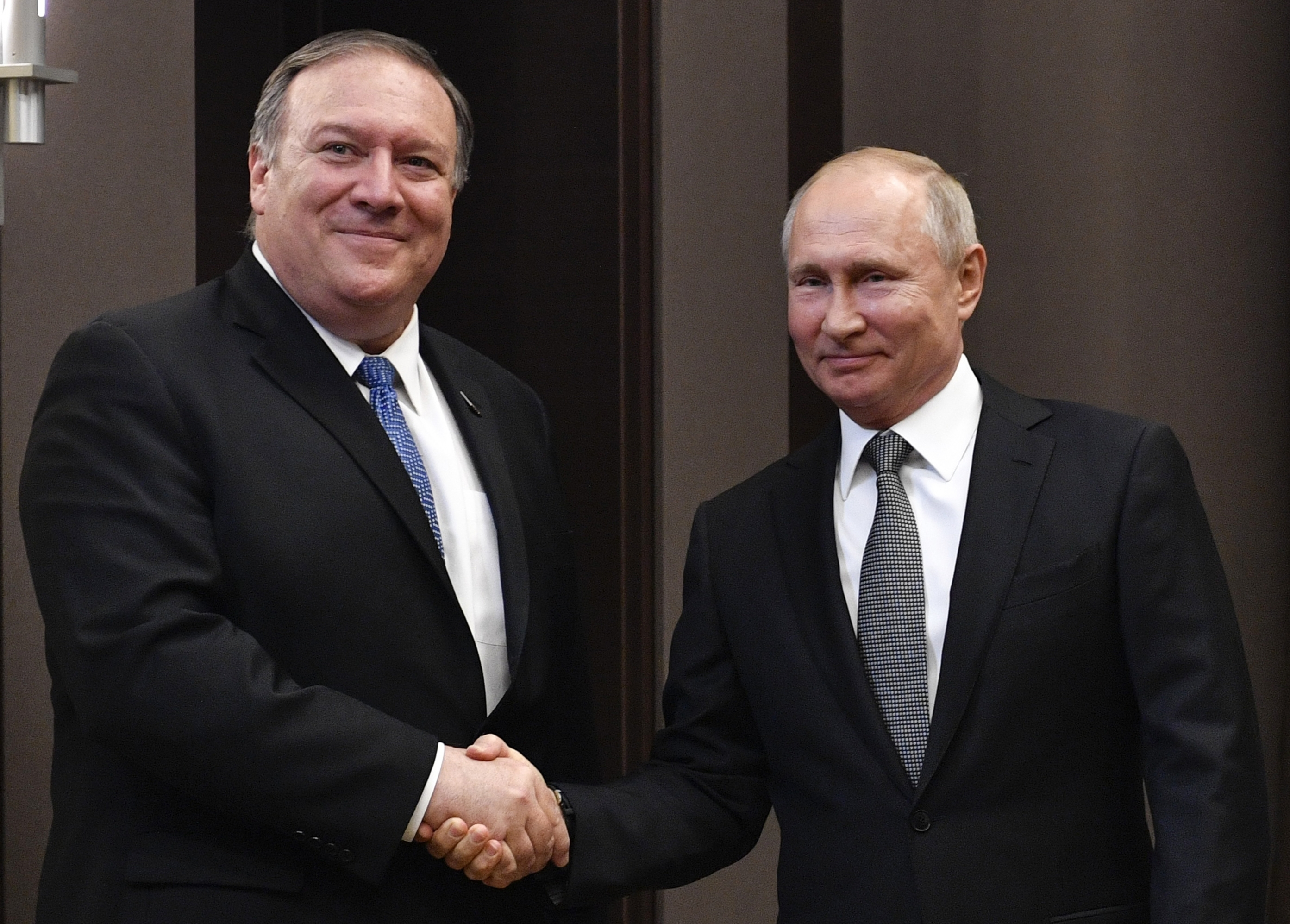 Russian President Vladimir Putin, right, and U.S. Secretary of State Mike Pompeo, pose for a photo before their talks in the Black Sea resort city of Sochi, southern Russia, May 14, 2019.