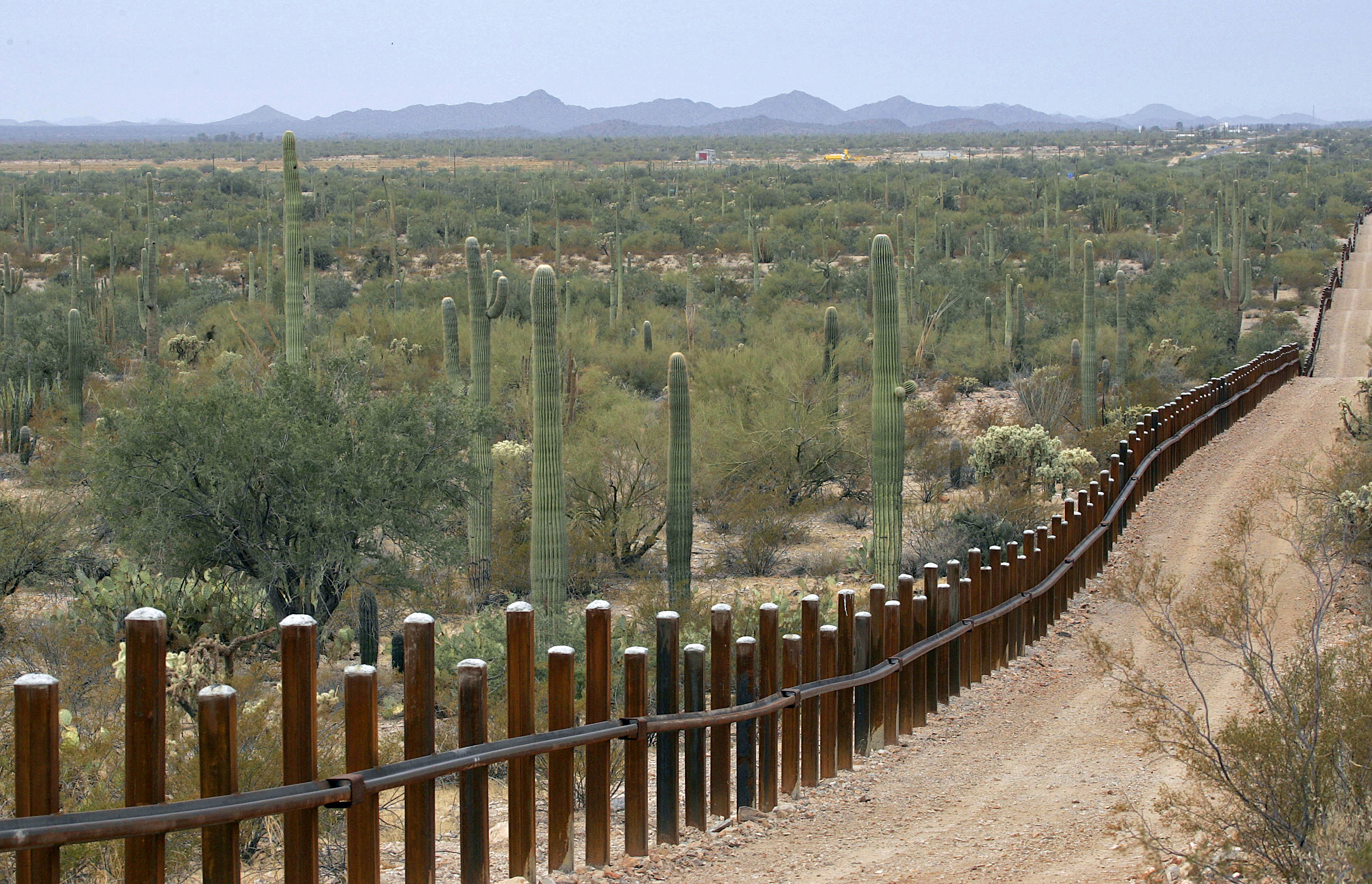FILE - The international border line made up of bollards separating Mexico, left from the United States, in the Organ Pipe National Monument near Lukeville, Ariz., Feb. 17, 2006.