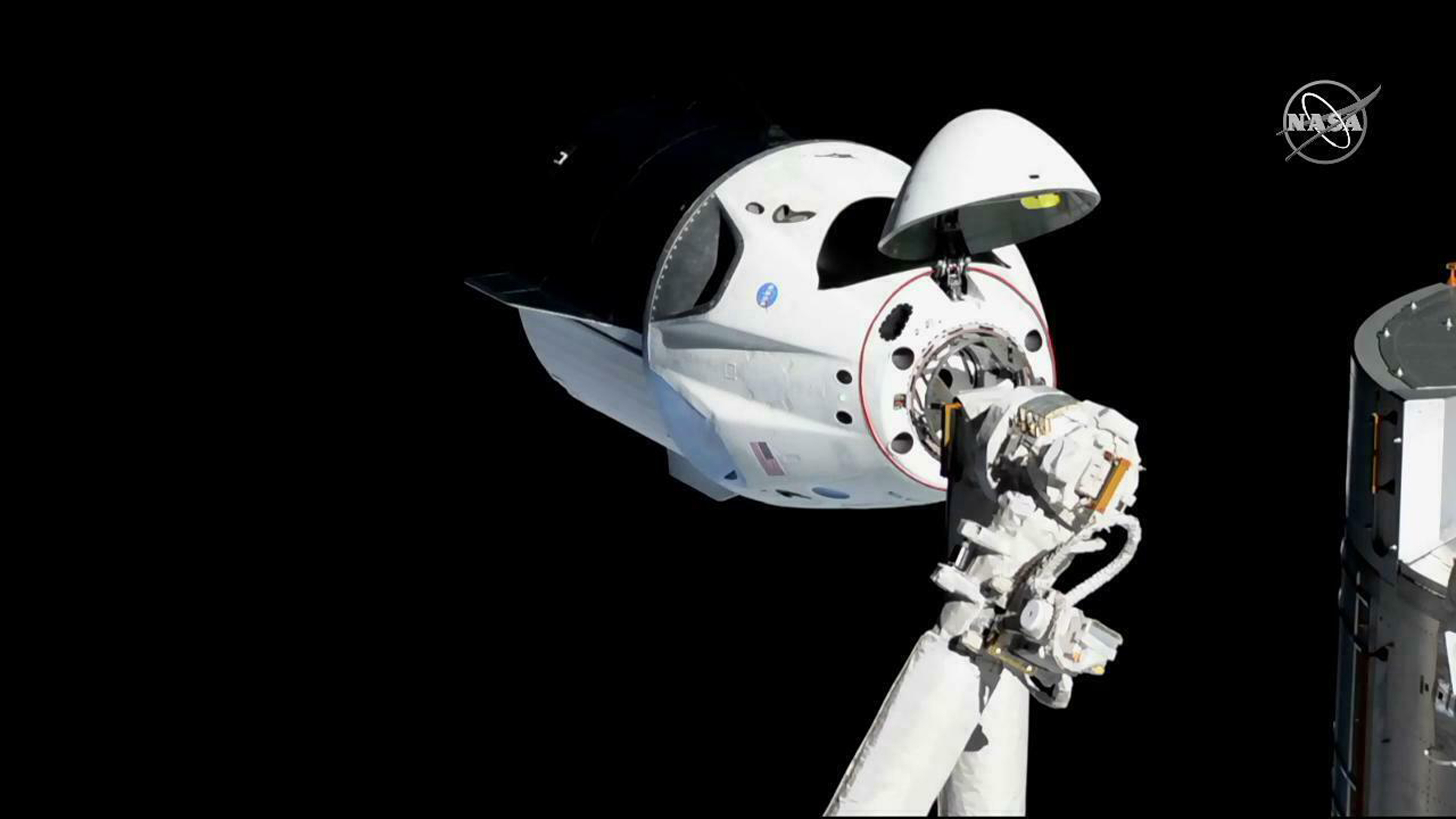 FILE - The SpaceX Crew Dragon capsule is pictured, March 3, 2019, about 20 meters (66 feet) from the International Space Station's Harmony module. SpaceX said May 2, 2019, that their Dragon capsule for astronauts was destroyed during a ground test, A...