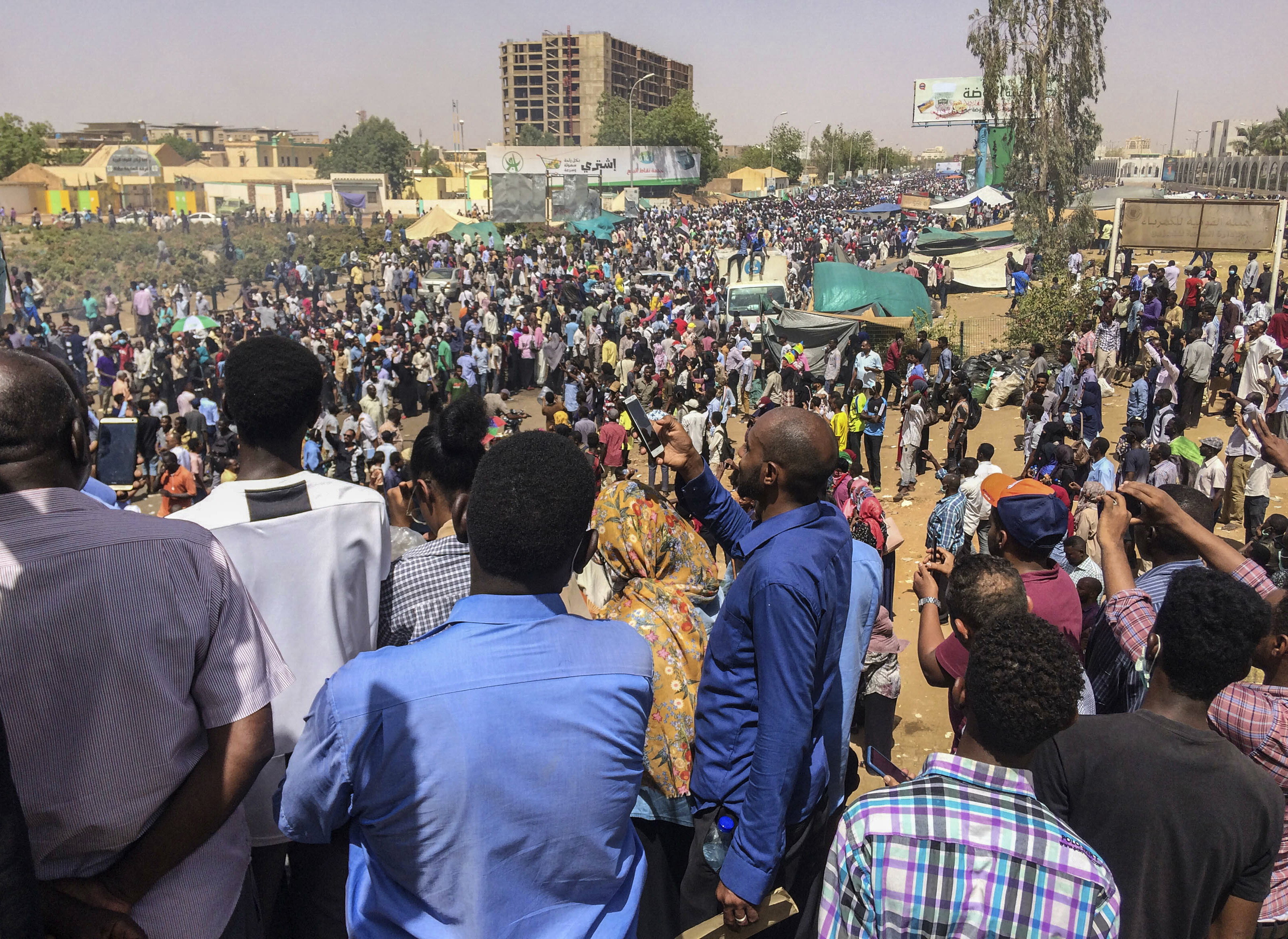 Protesters rally at a demonstration near the military headquarters, April 9, 2019, in the capital Khartoum, Sudan.