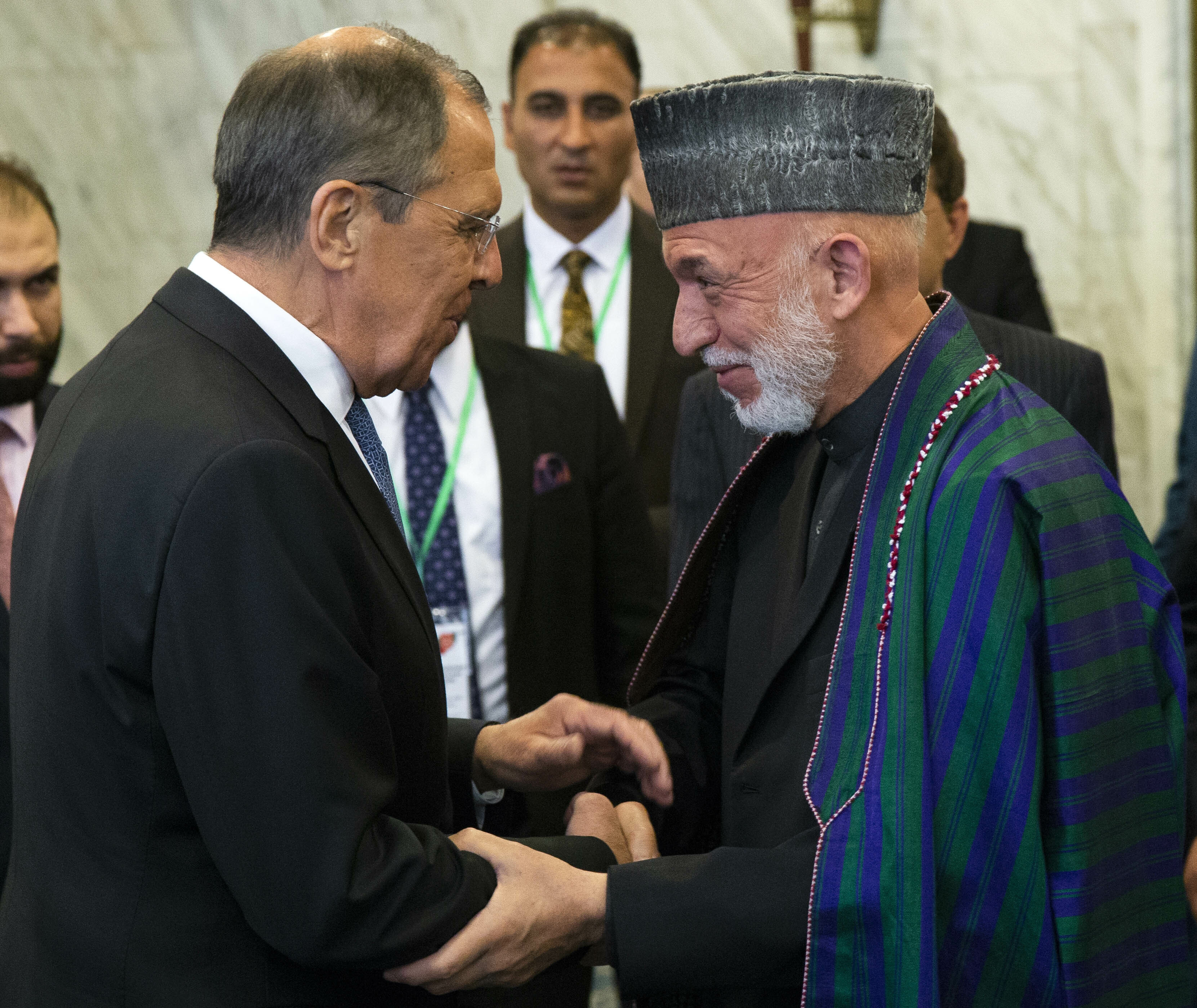 Russian Foreign Minister Sergey Lavrov, left, and former Afghan President Hamid Karzai greet each other prior to their meeting in Moscow, May 28, 2019.
